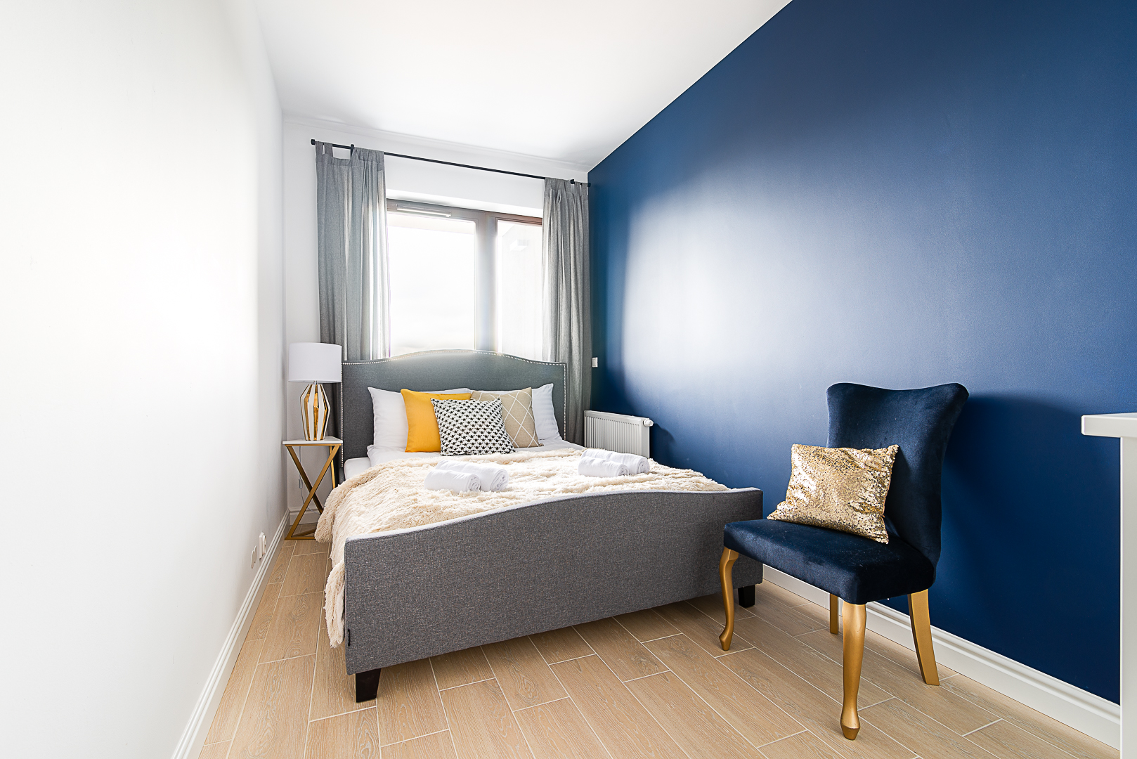 Stylish bedroom at Klopot Apartments