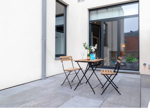 Terrace table at Luxembourg Apartment
