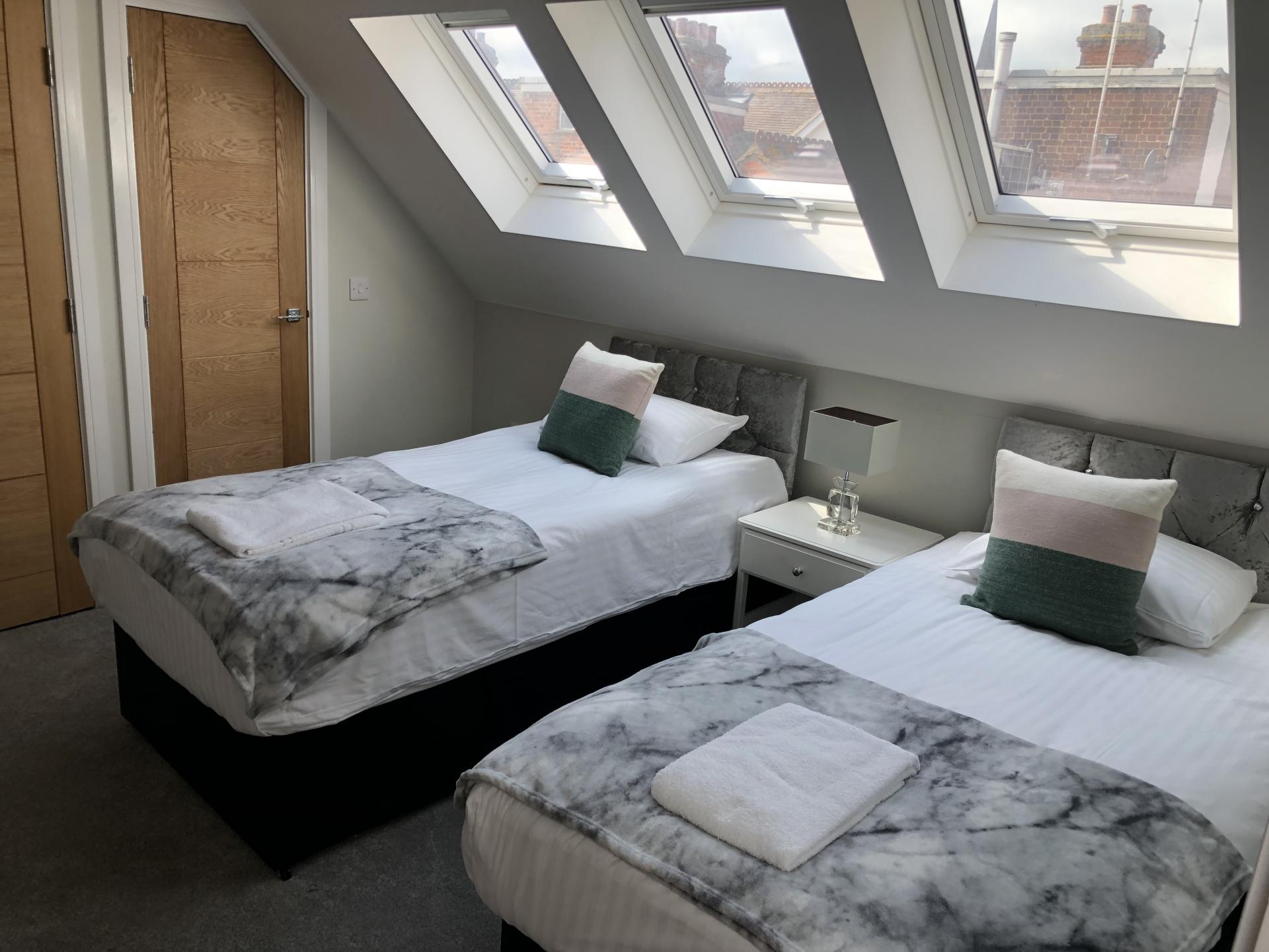 Twin beds at Wilson Heights Apartment
