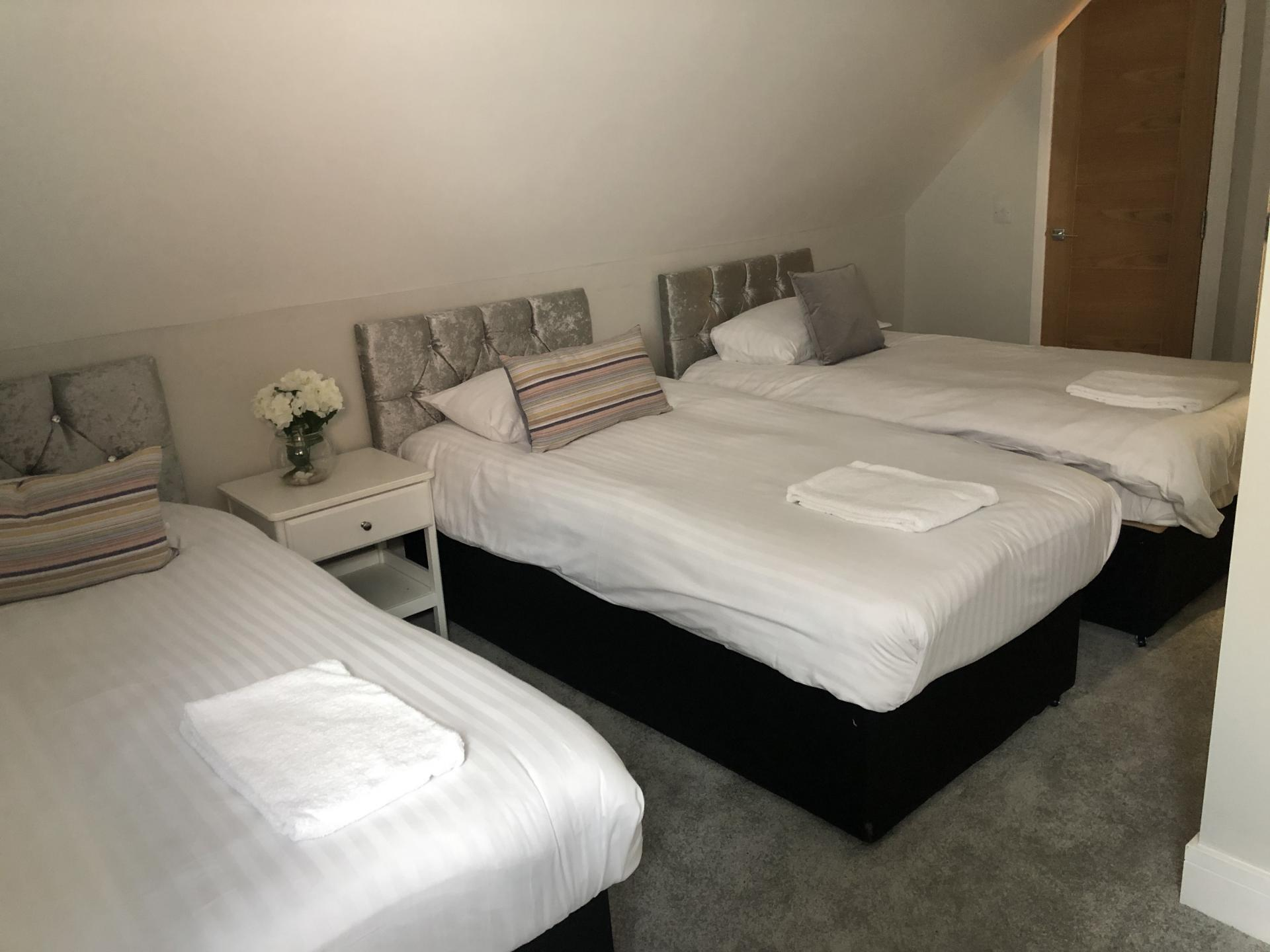 Three single beds at Wilson Heights Apartment