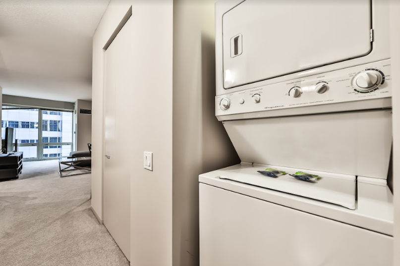 Laundry facilities at 215 West Serviced Apartment