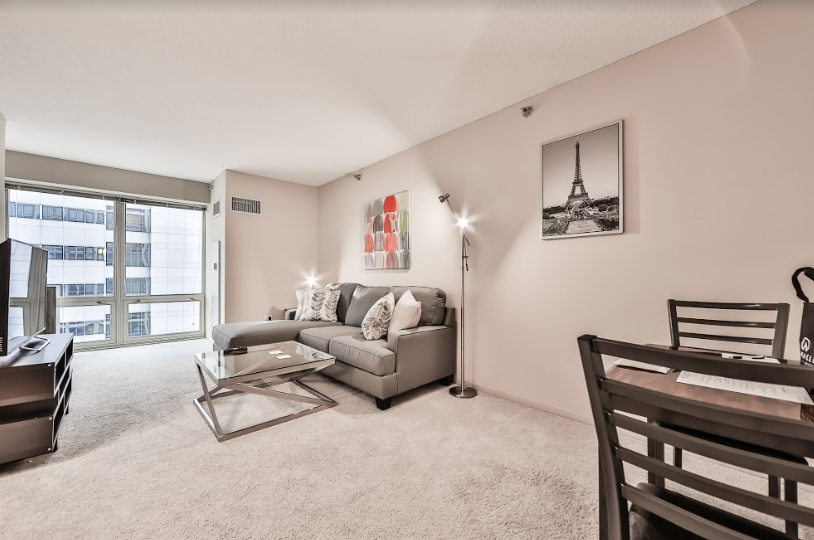 Spacious living area at 215 West Serviced Apartment