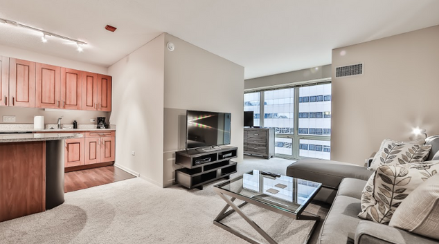 Living room at 215 West Serviced Apartment