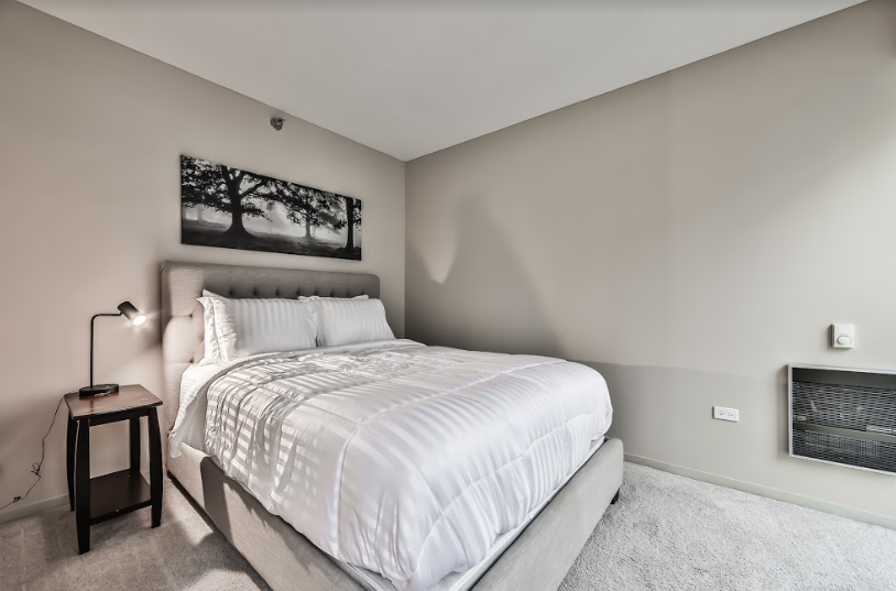 Bedroom at 215 West Serviced Apartment