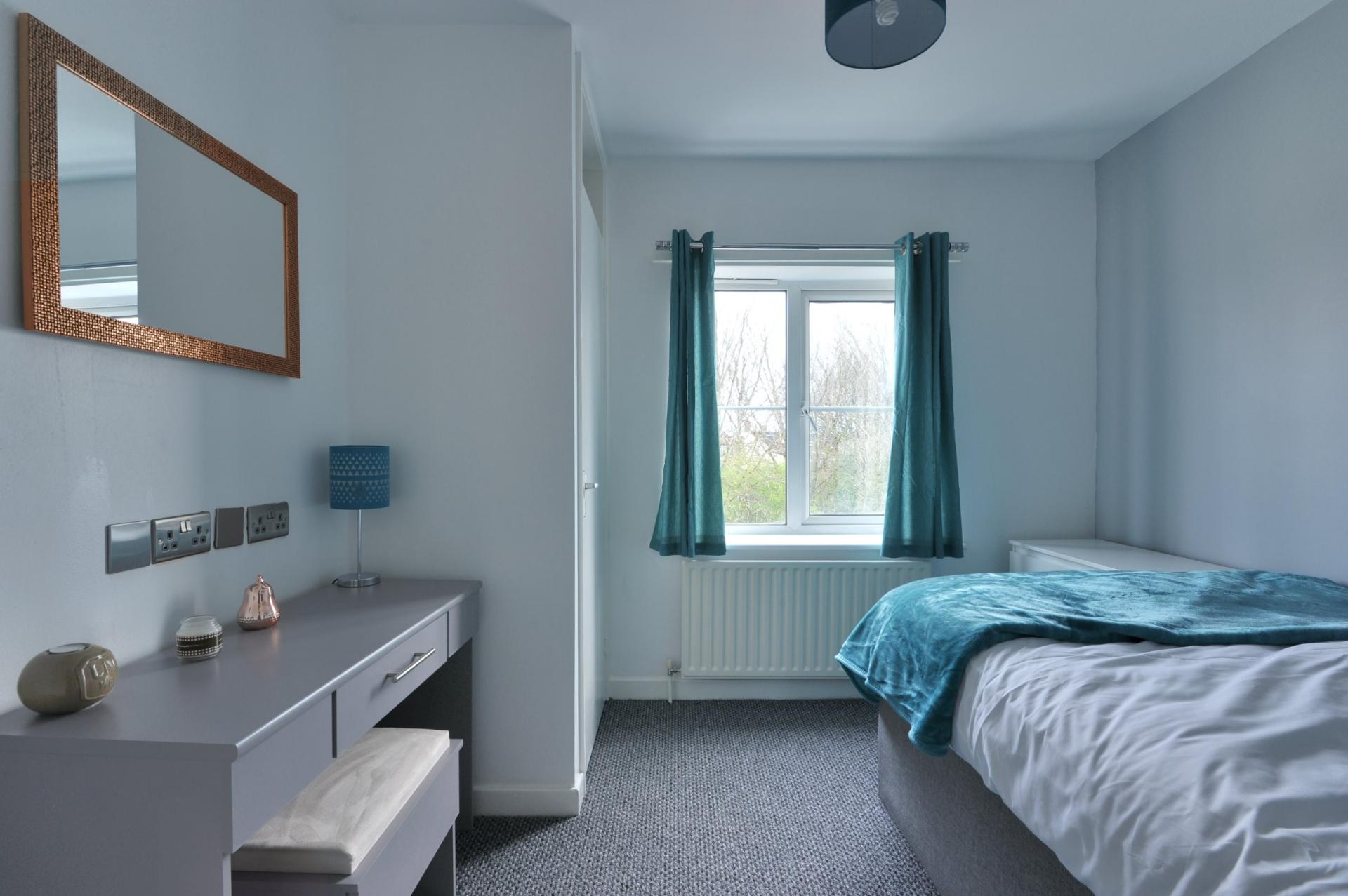 Bright bedroom at Langton House Apartments