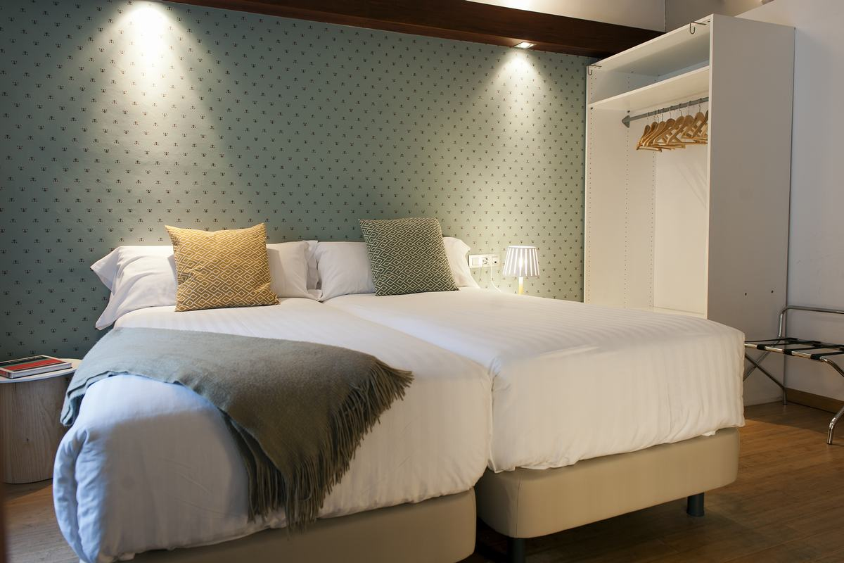 Modern bed at MH Apartments Princesa