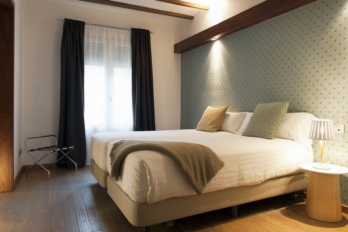 Bright bedroom at MH Apartments Princesa