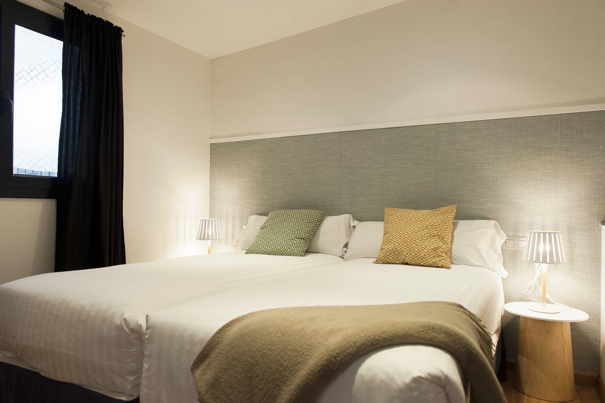 Comfortable bed at MH Apartments Princesa