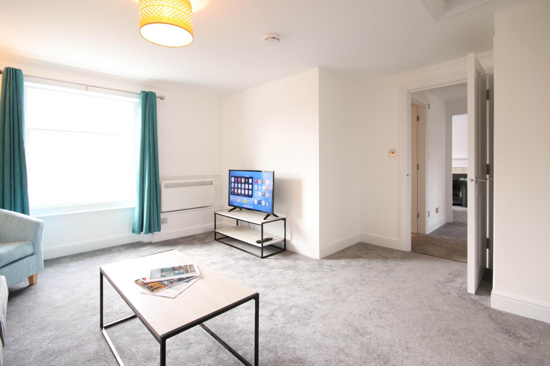 Spacious living area at Bridge Street Apartments