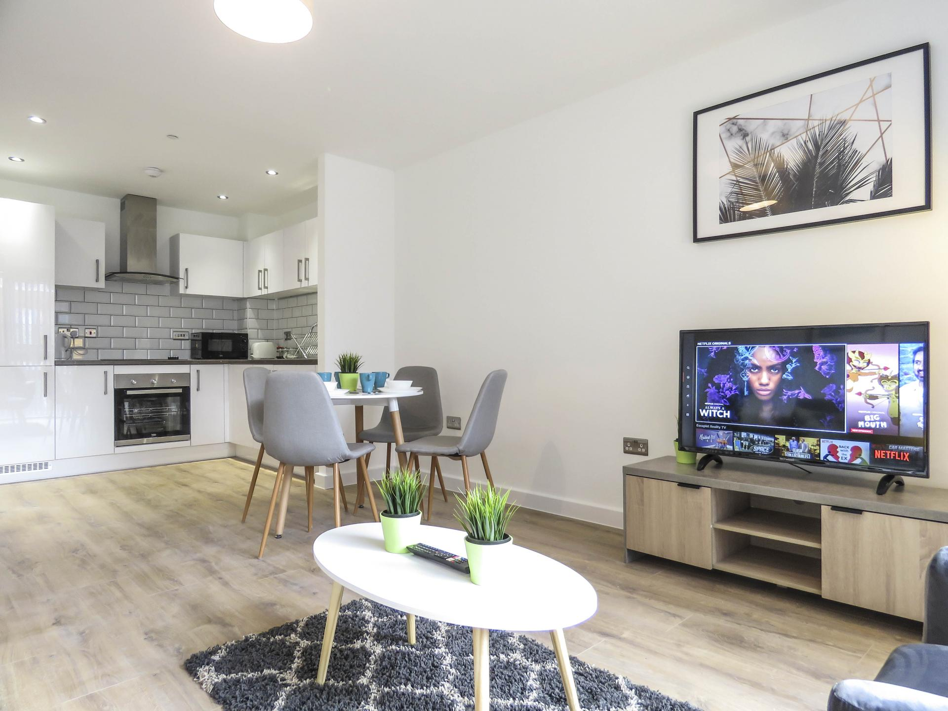 Open-plan living area at Canal Side Serviced Apartments