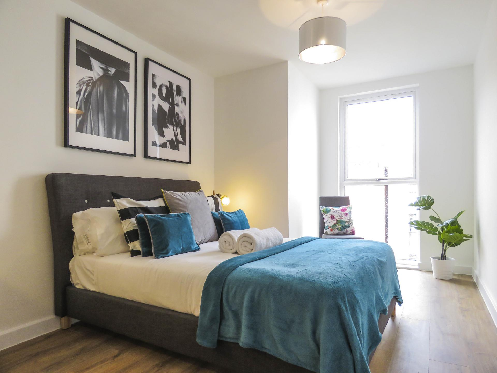 Double bed at Canal Side Serviced Apartments