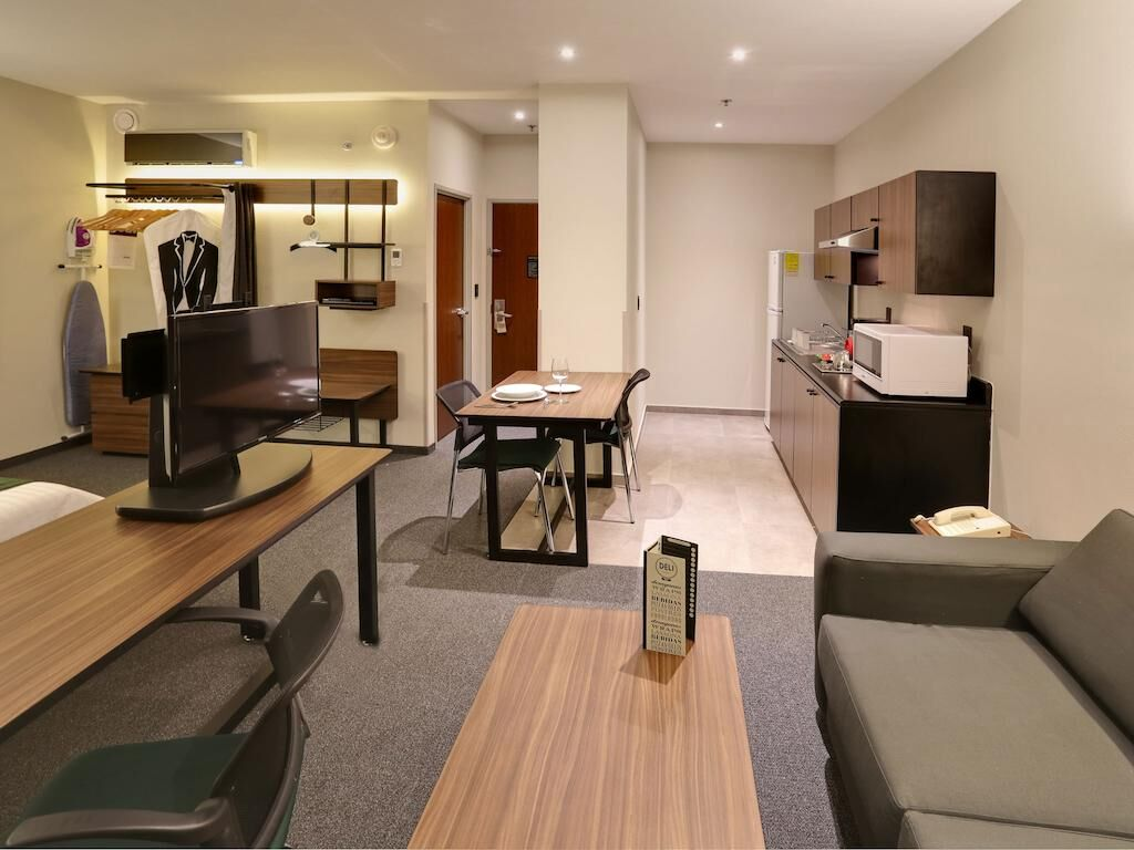 Living area at City Express Apartment