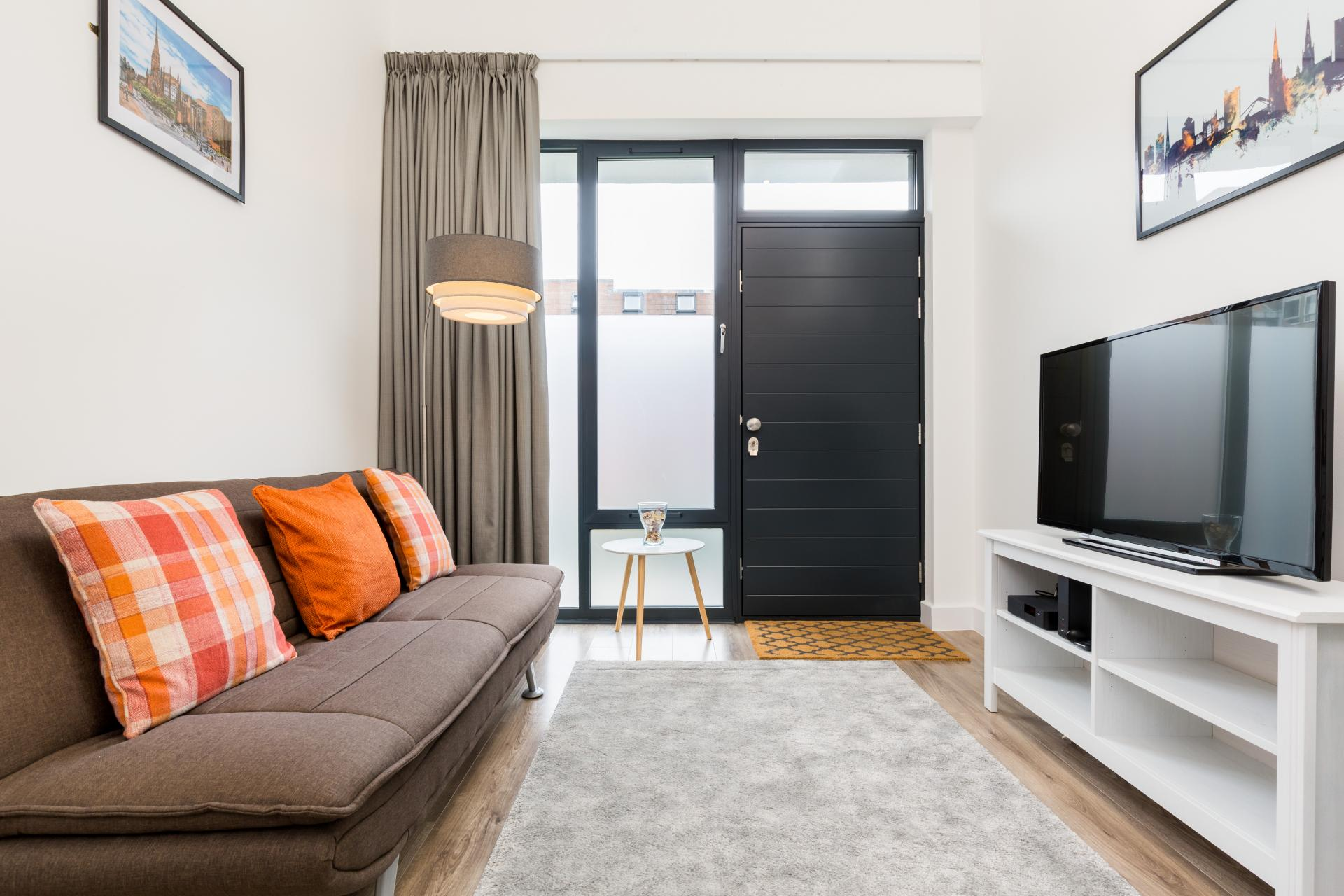 Living room at Queens House Serviced Apartment