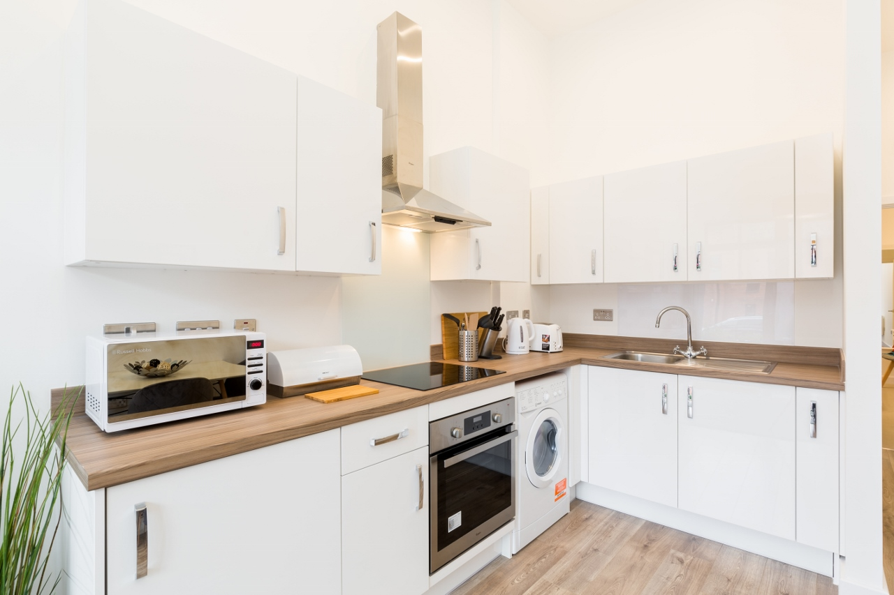 Kitchen at Queens House Serviced Apartment