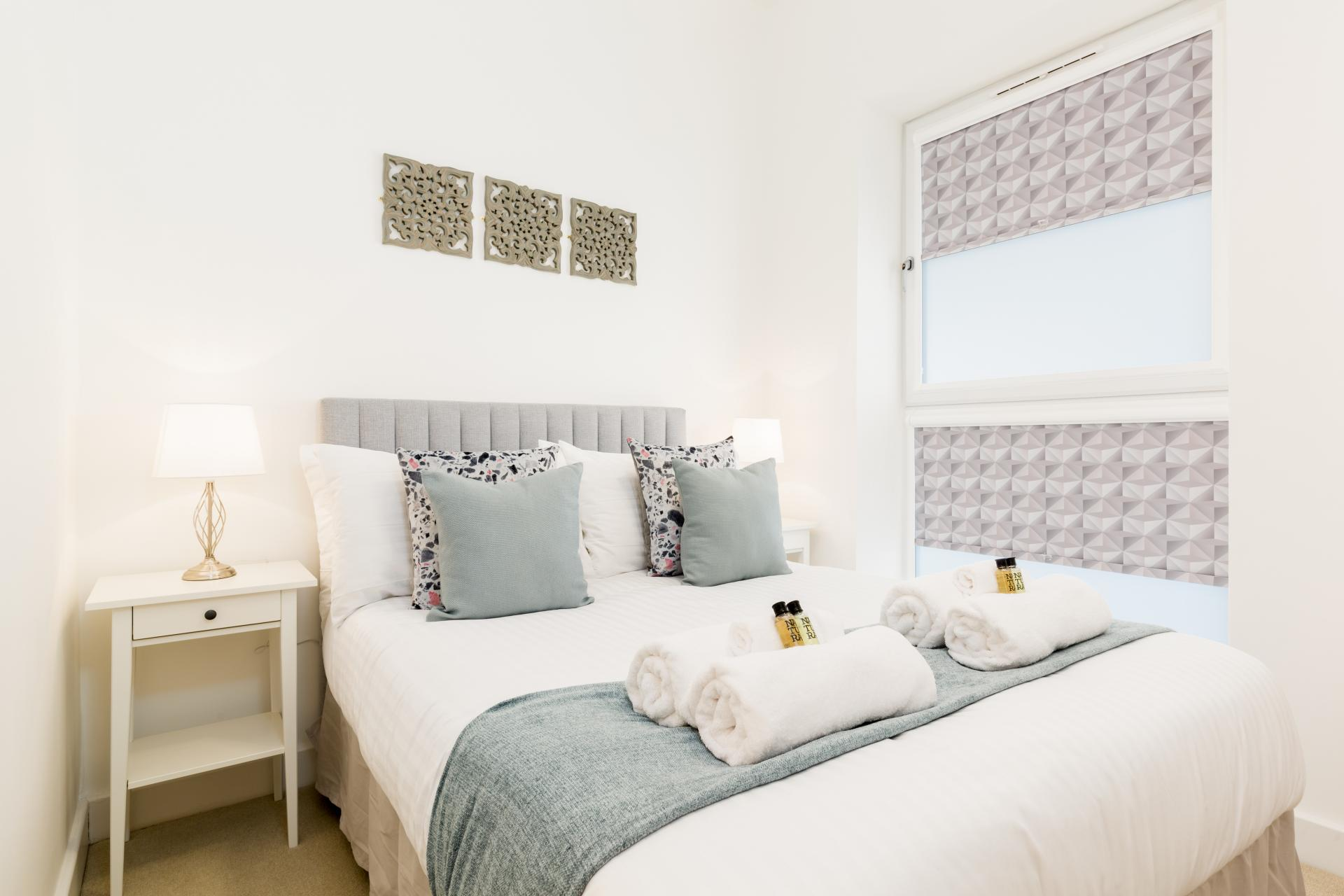 Bedroom at Queens House Serviced Apartment