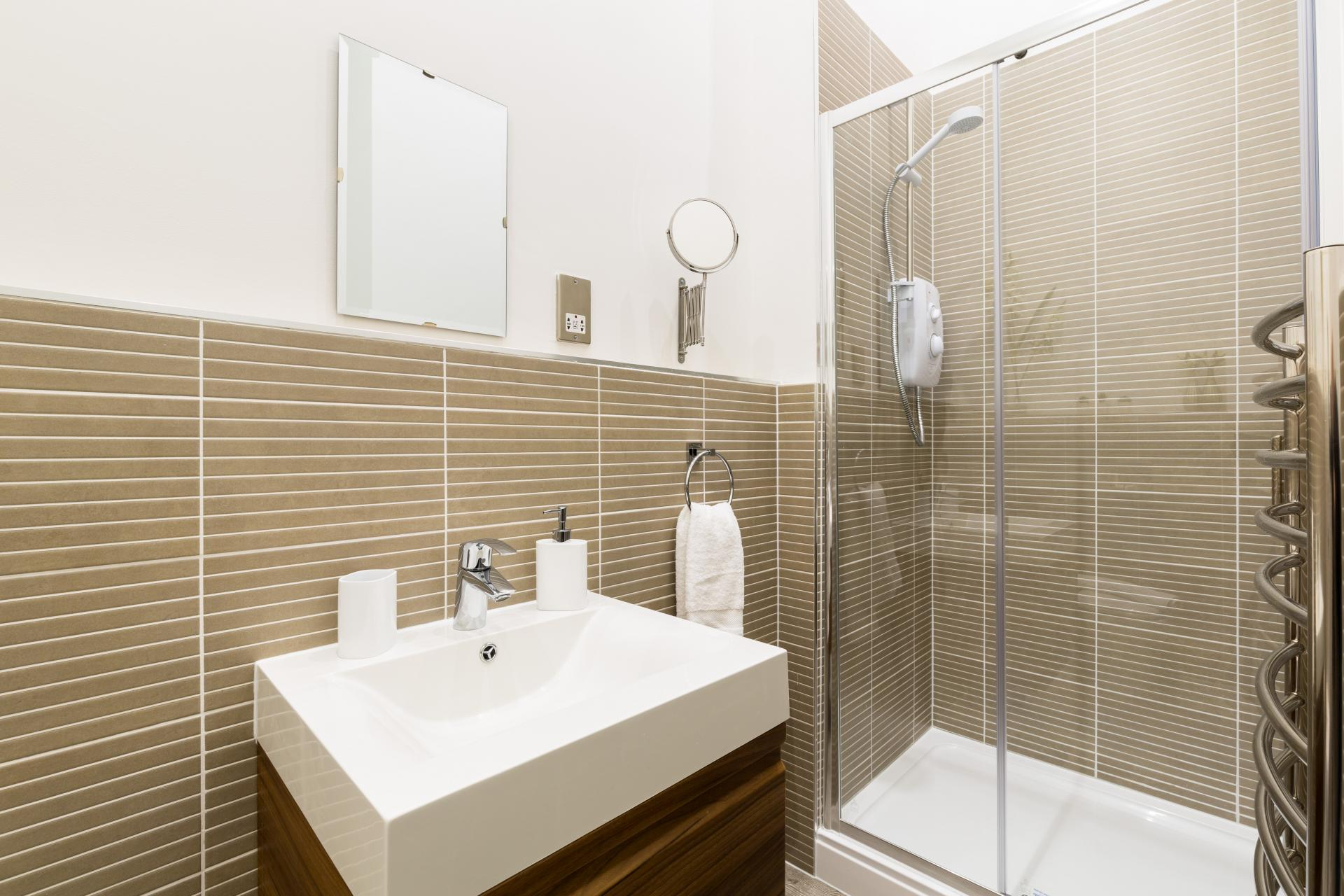 Bathroom at Queens House Serviced Apartment