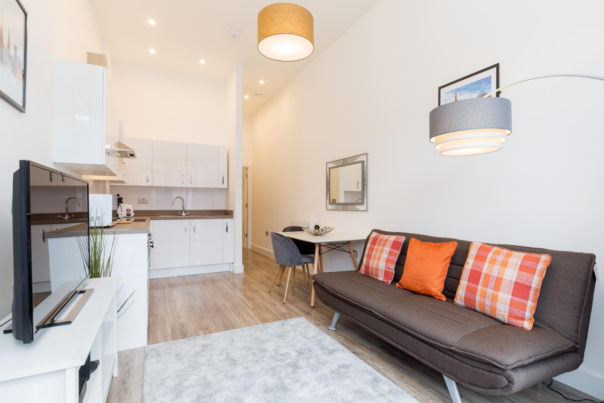 Open plan lounge at Queens House Serviced Apartment