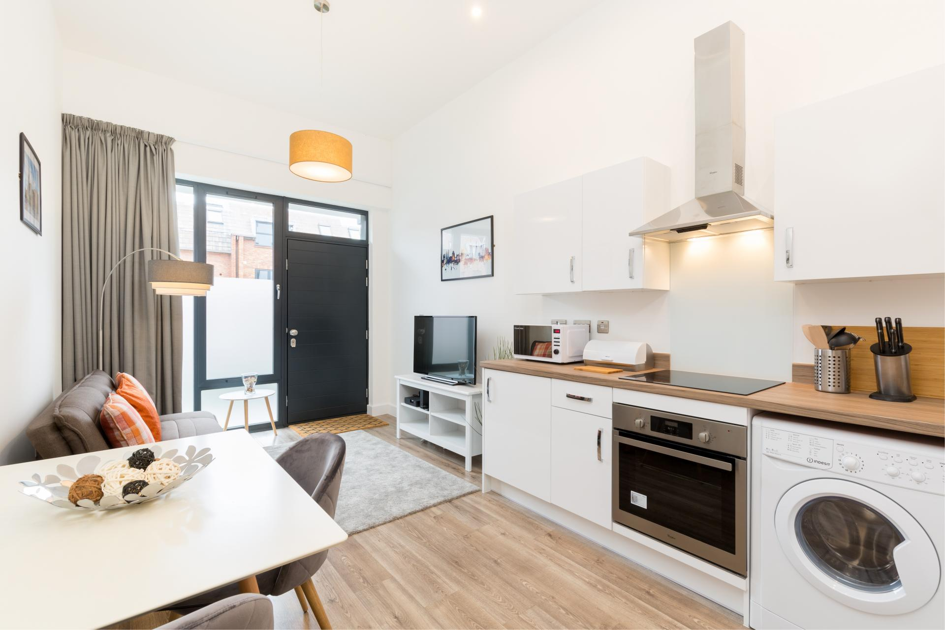 Open plan kitchen at Queens House Serviced Apartment