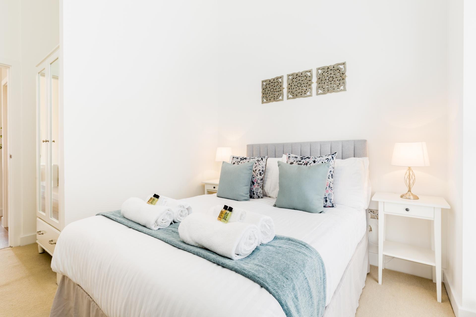 Double bed at Queens House Serviced Apartment