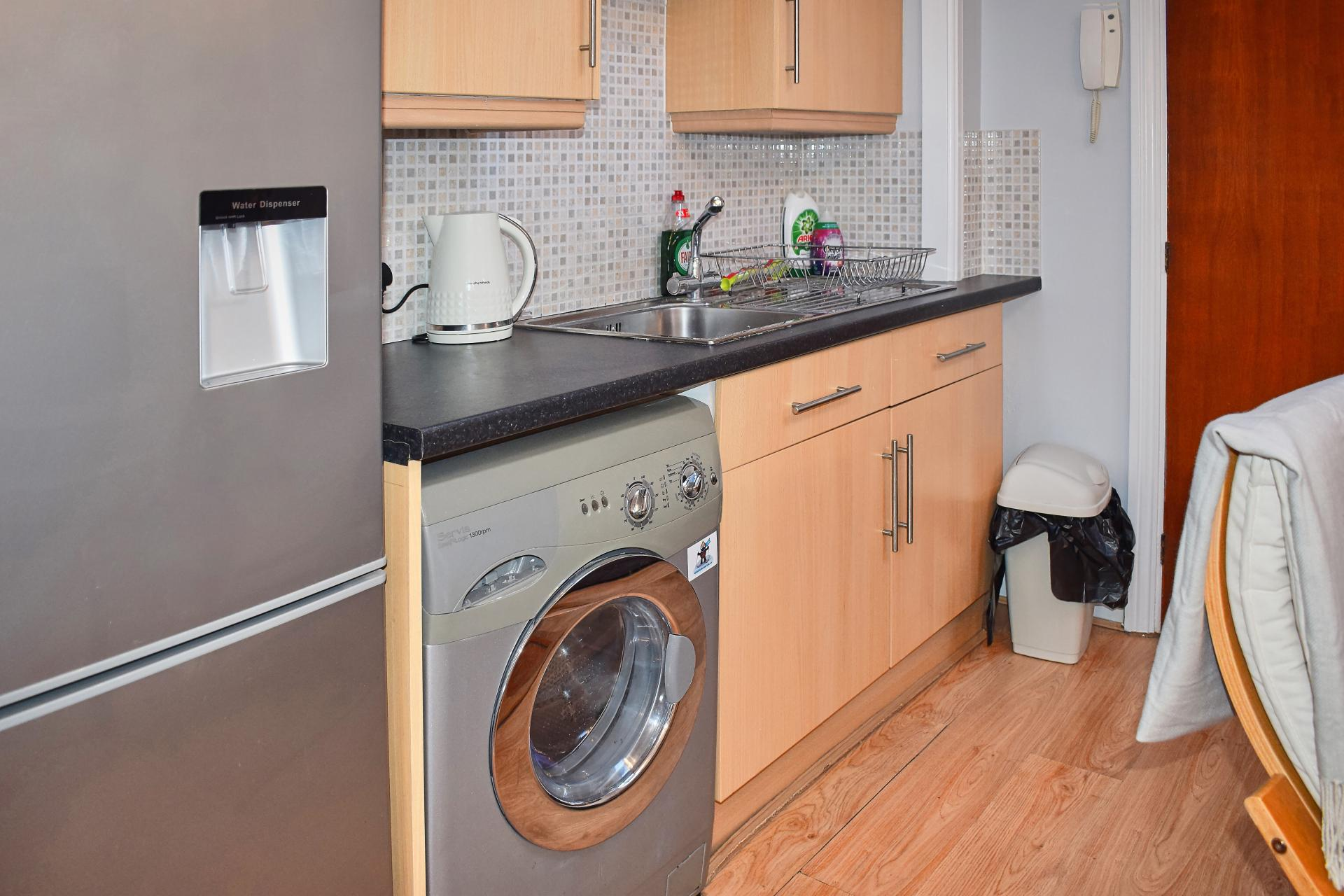 Washer dryer at Market Street Studio Apartment