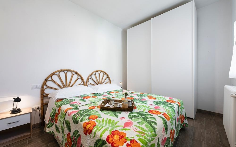 Double bed at Serenity Apartment