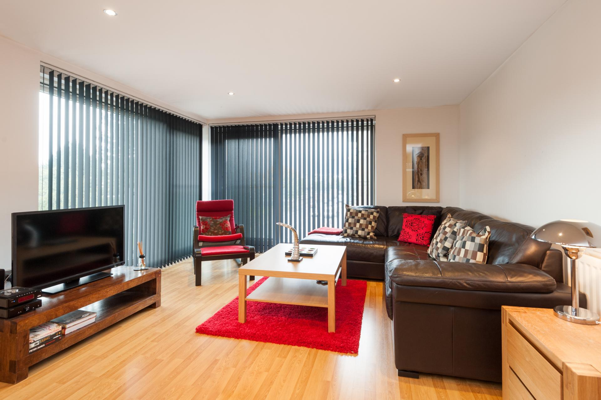 Living room at Metropole Apartment