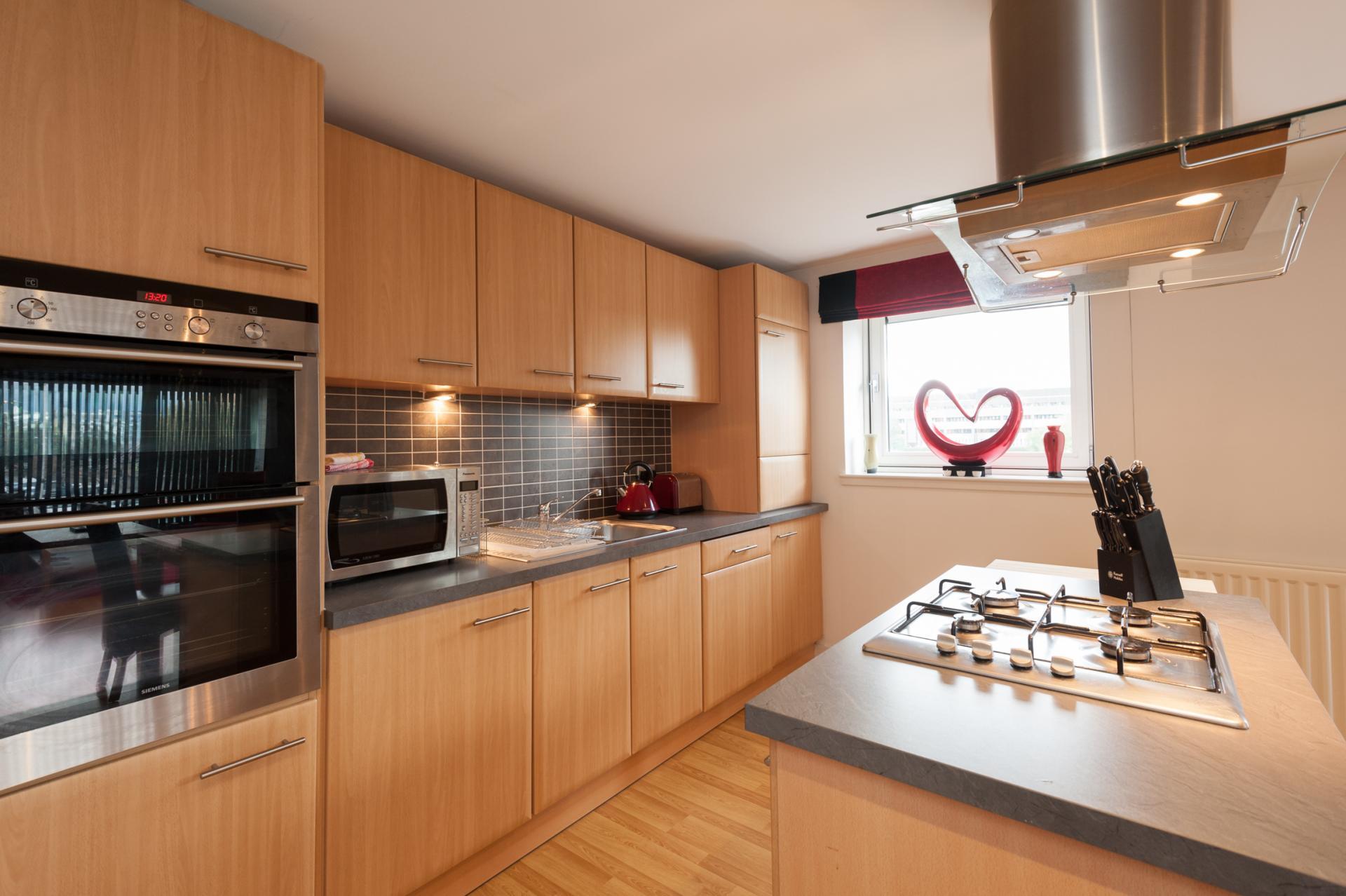 Kitchen area at Metropole Apartment