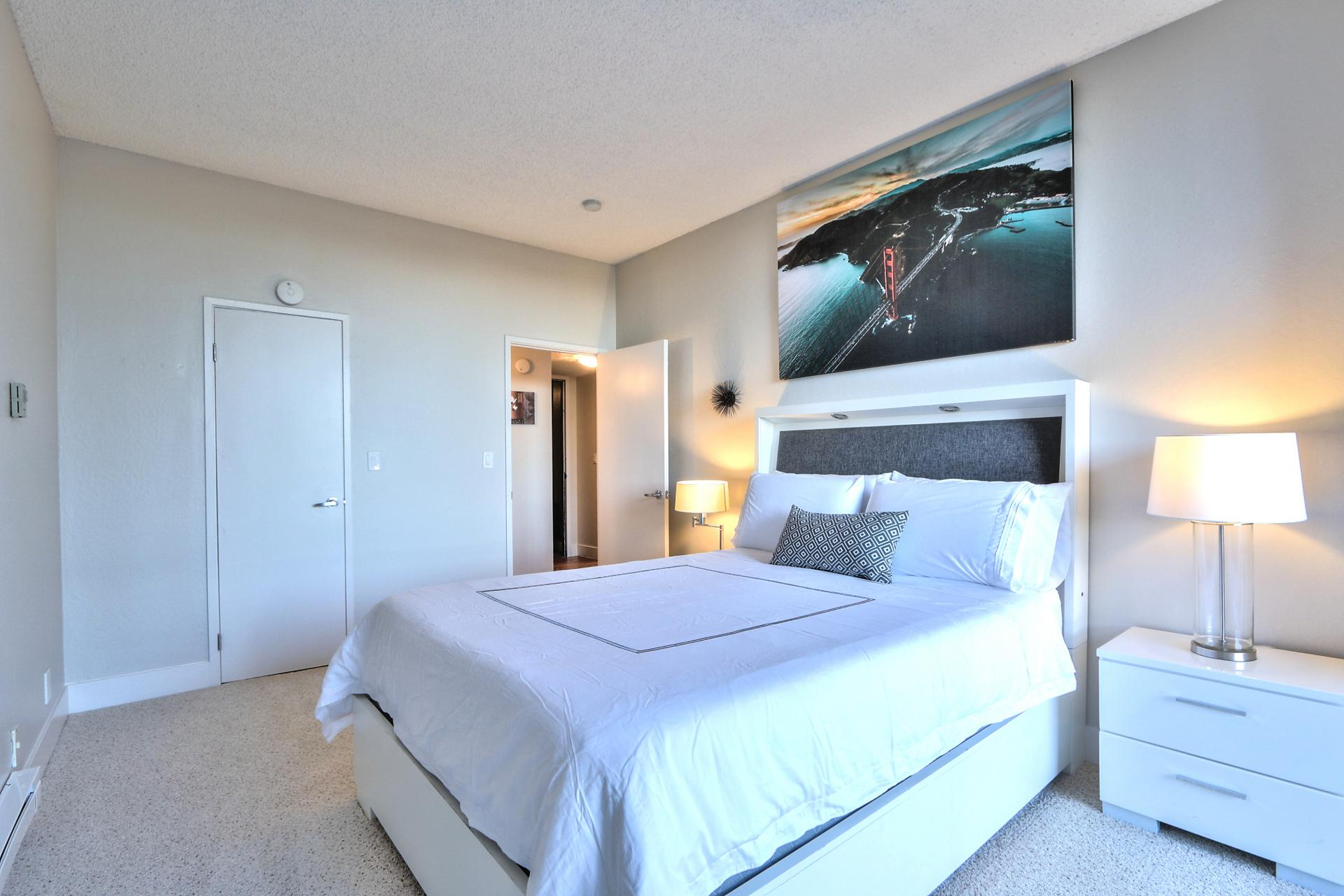 Bright bedroom at The Marc Serviced Apartments
