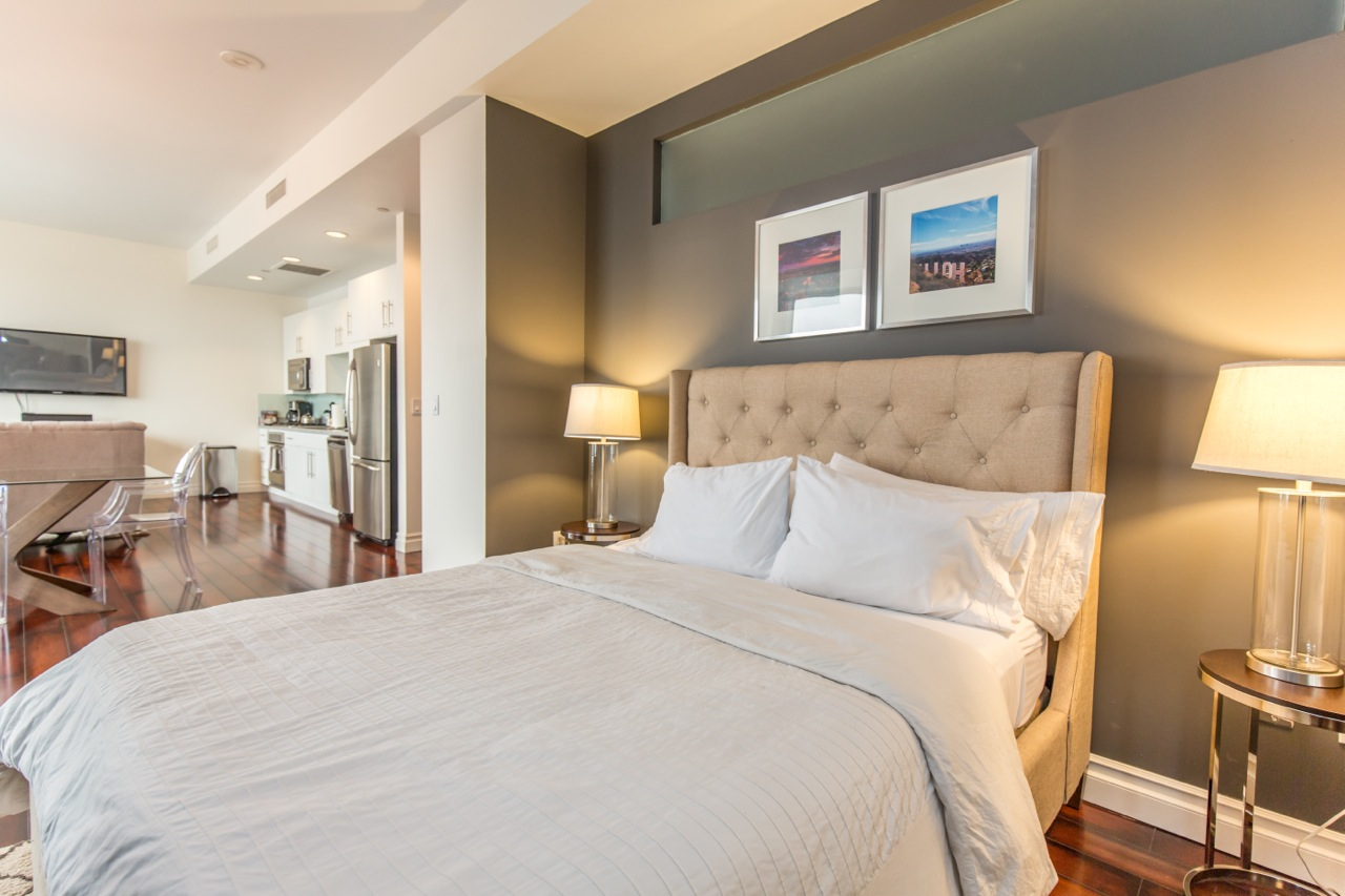Double bed at 1100 Wilshire Apartment