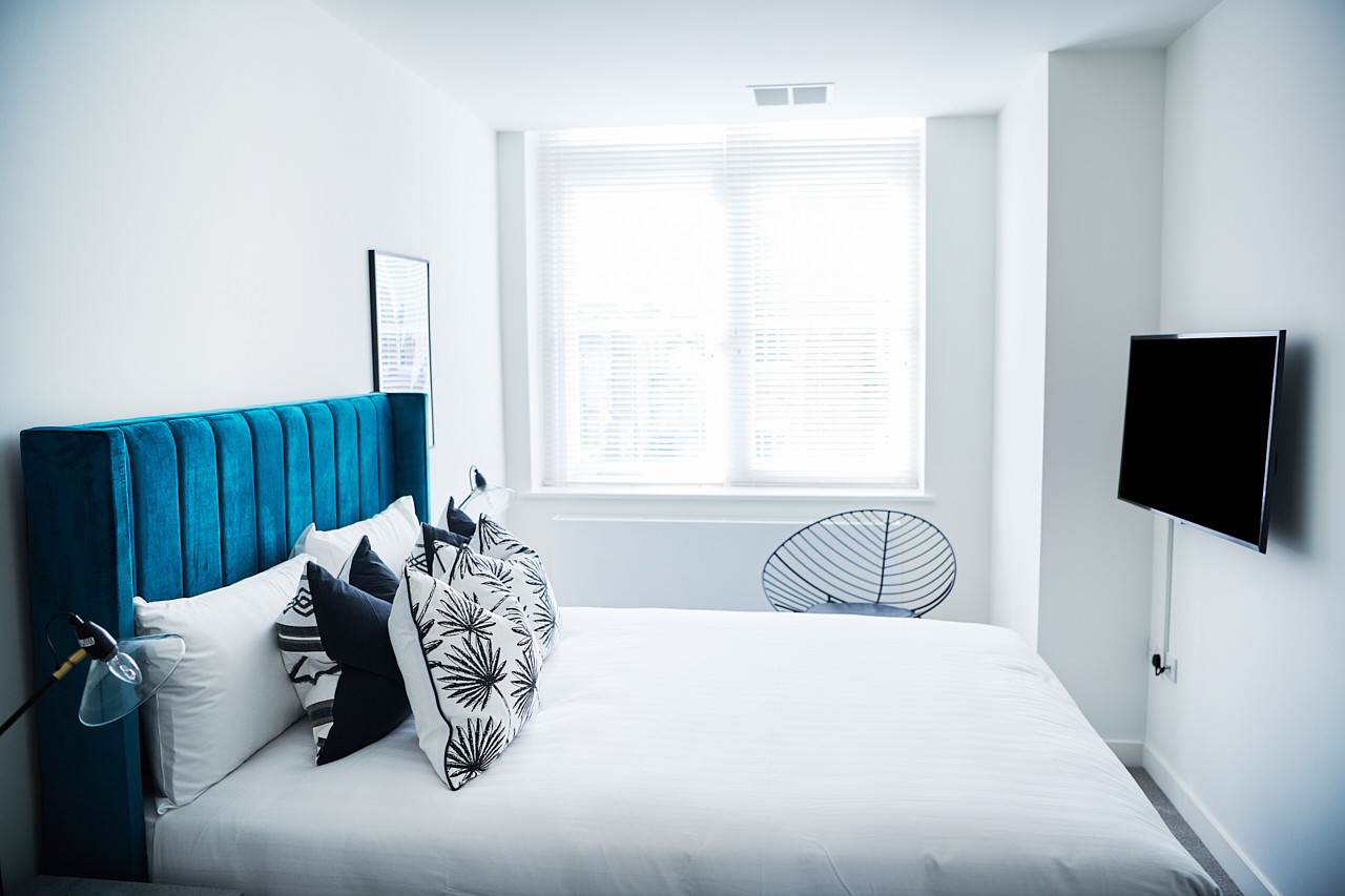 Bright bedroom at The Residence at Shoreditch Apartments