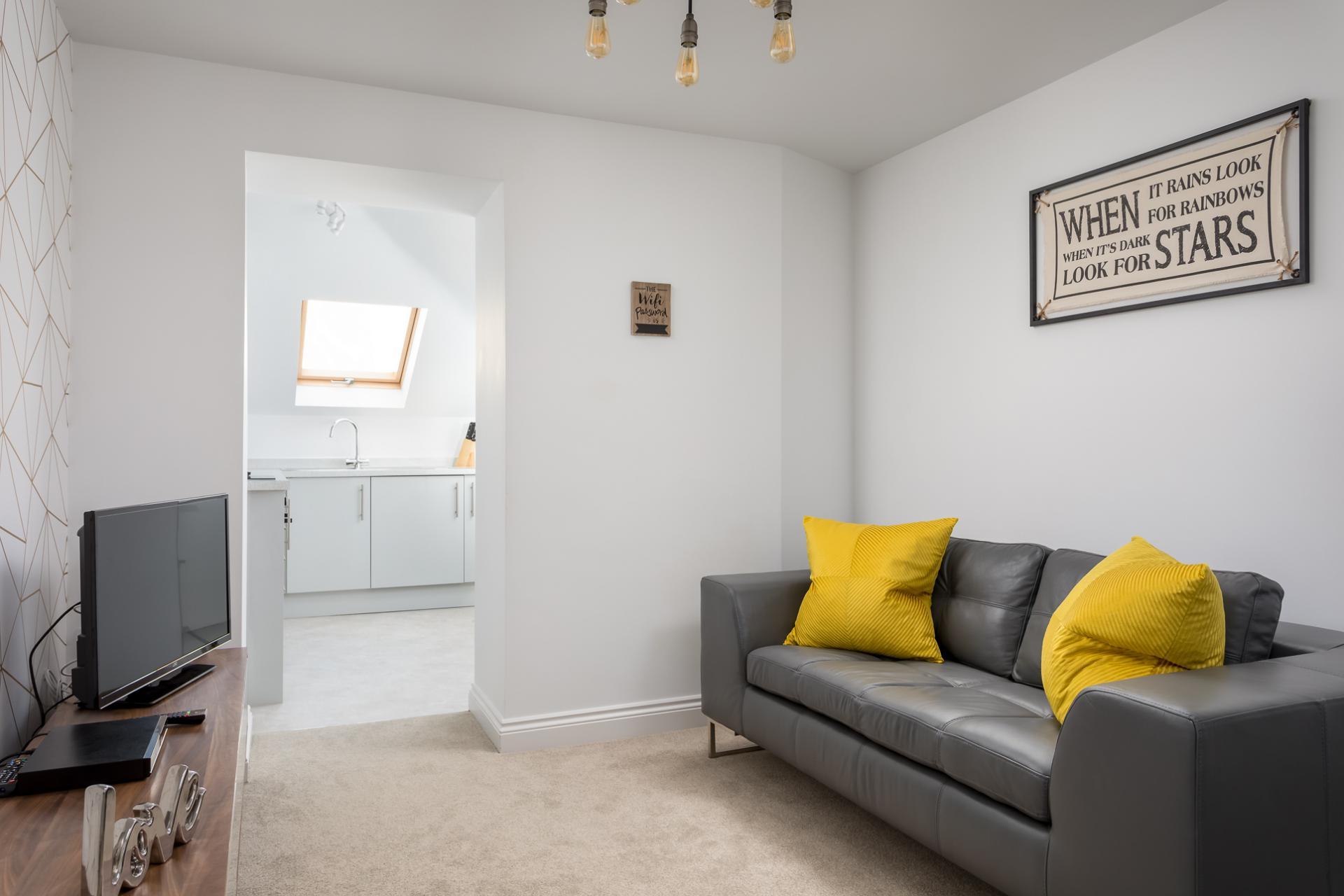 Living room at Axiom No. 8 Apartment
