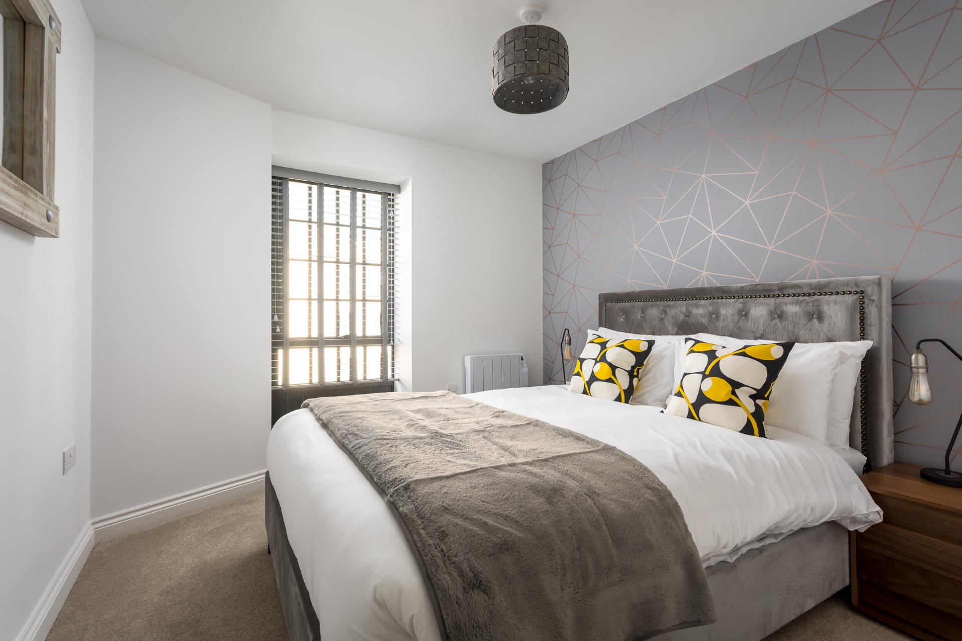 Bedroom at Axiom No. 8 Apartment