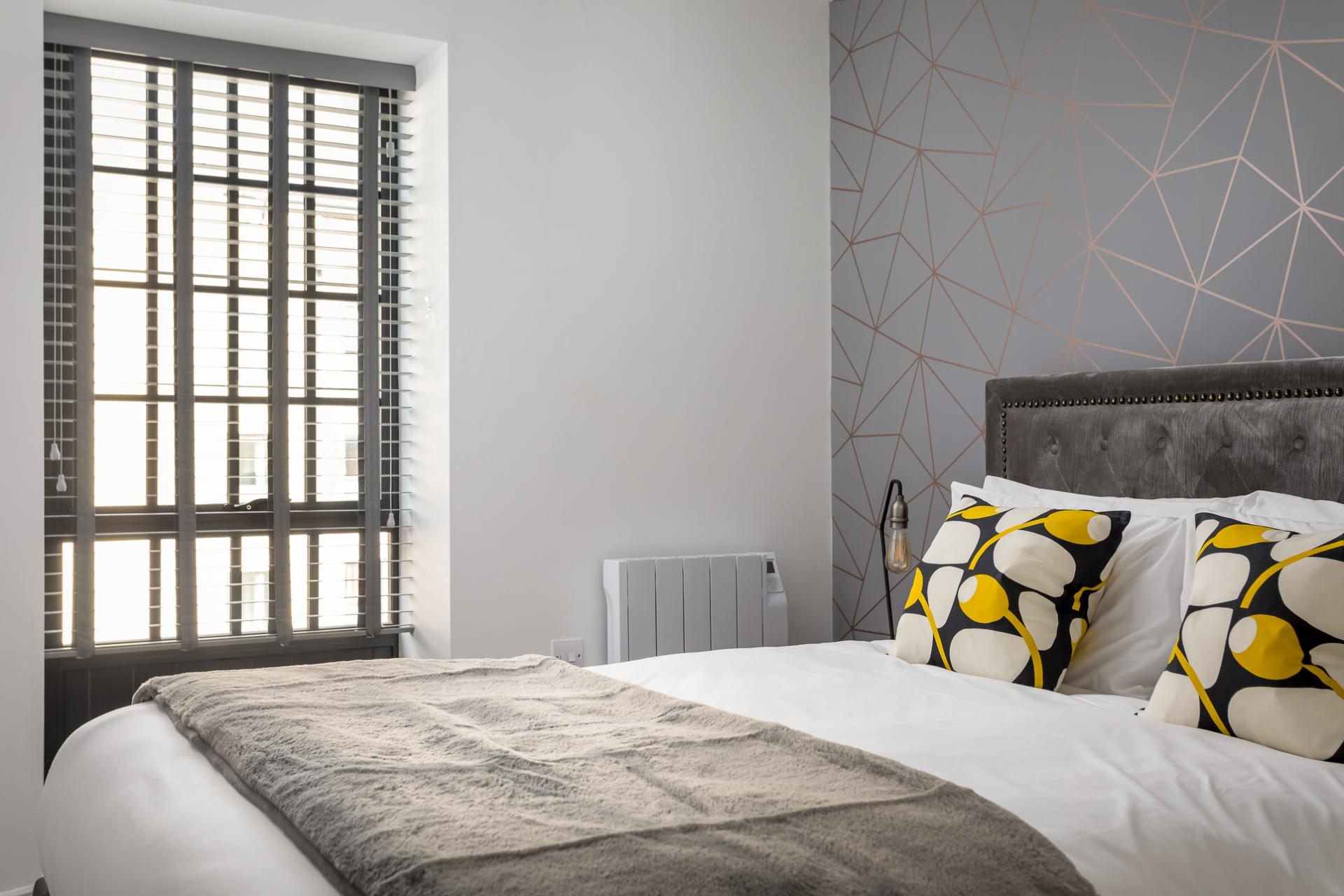 Bright bedroom at Axiom No. 8 Apartment
