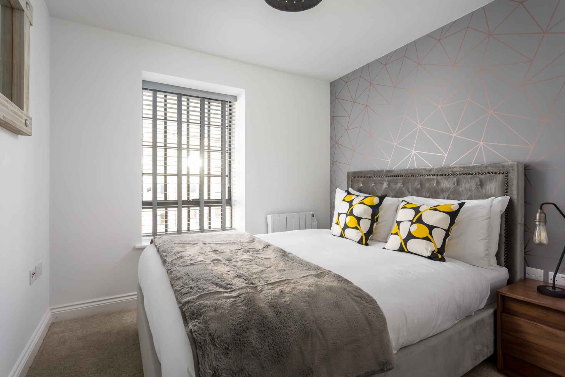 Large bed at Axiom No. 8 Apartment