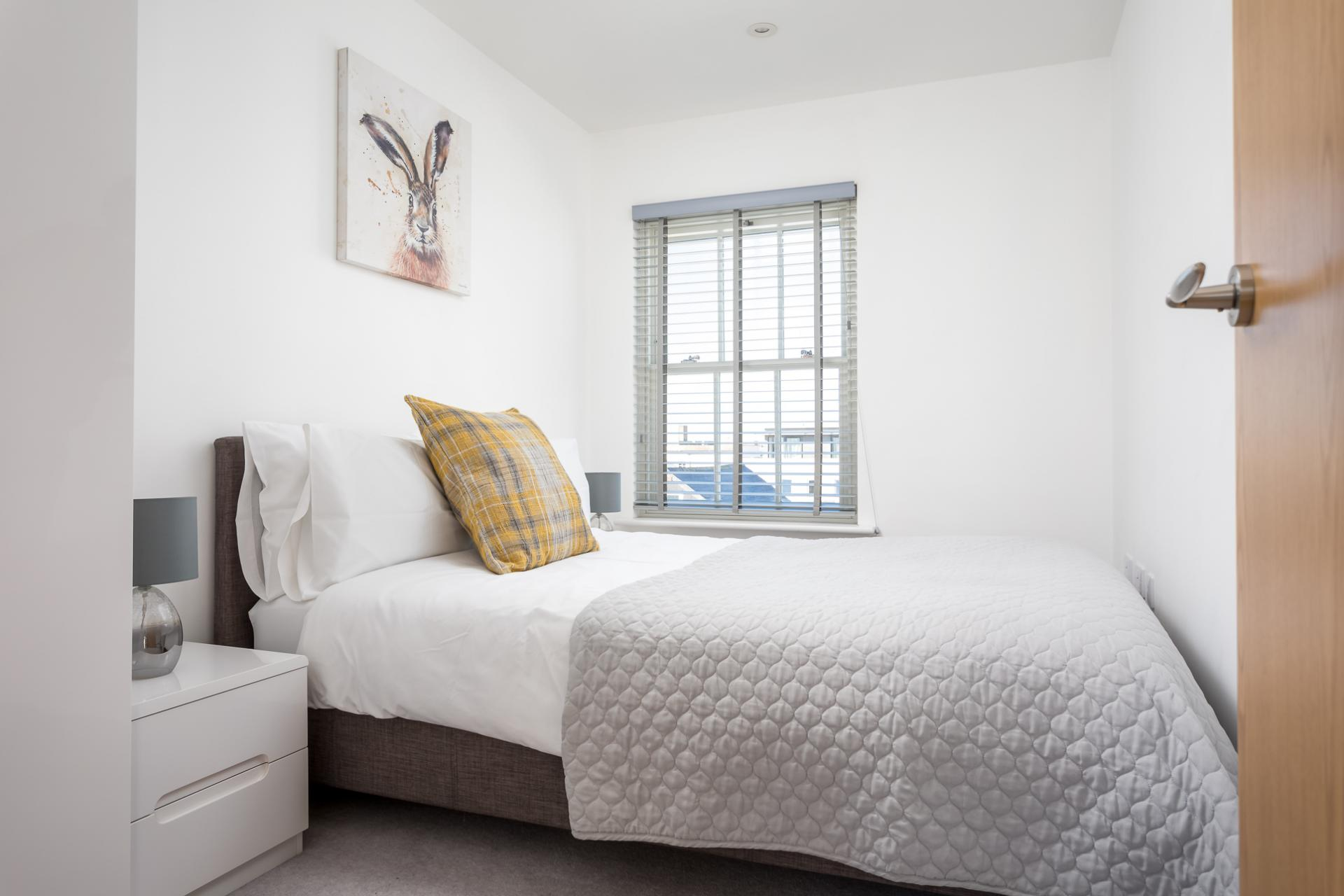 Bed at Prince Regent Mews Apartment