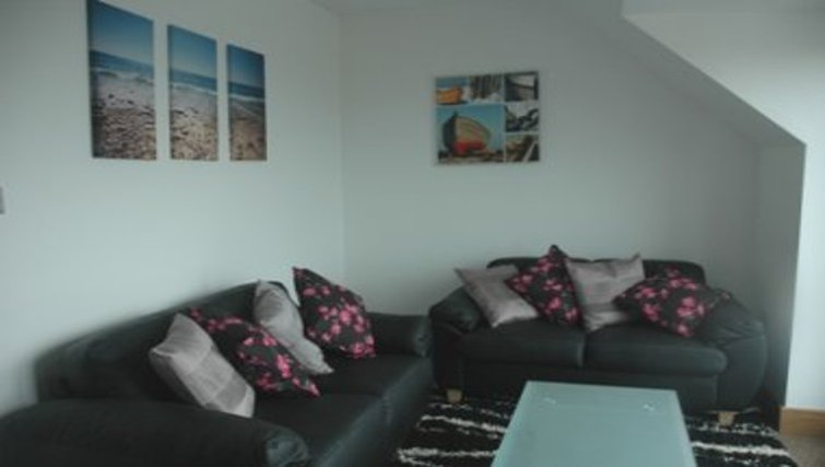 Attractive living area in Waves Guernsey Apartment