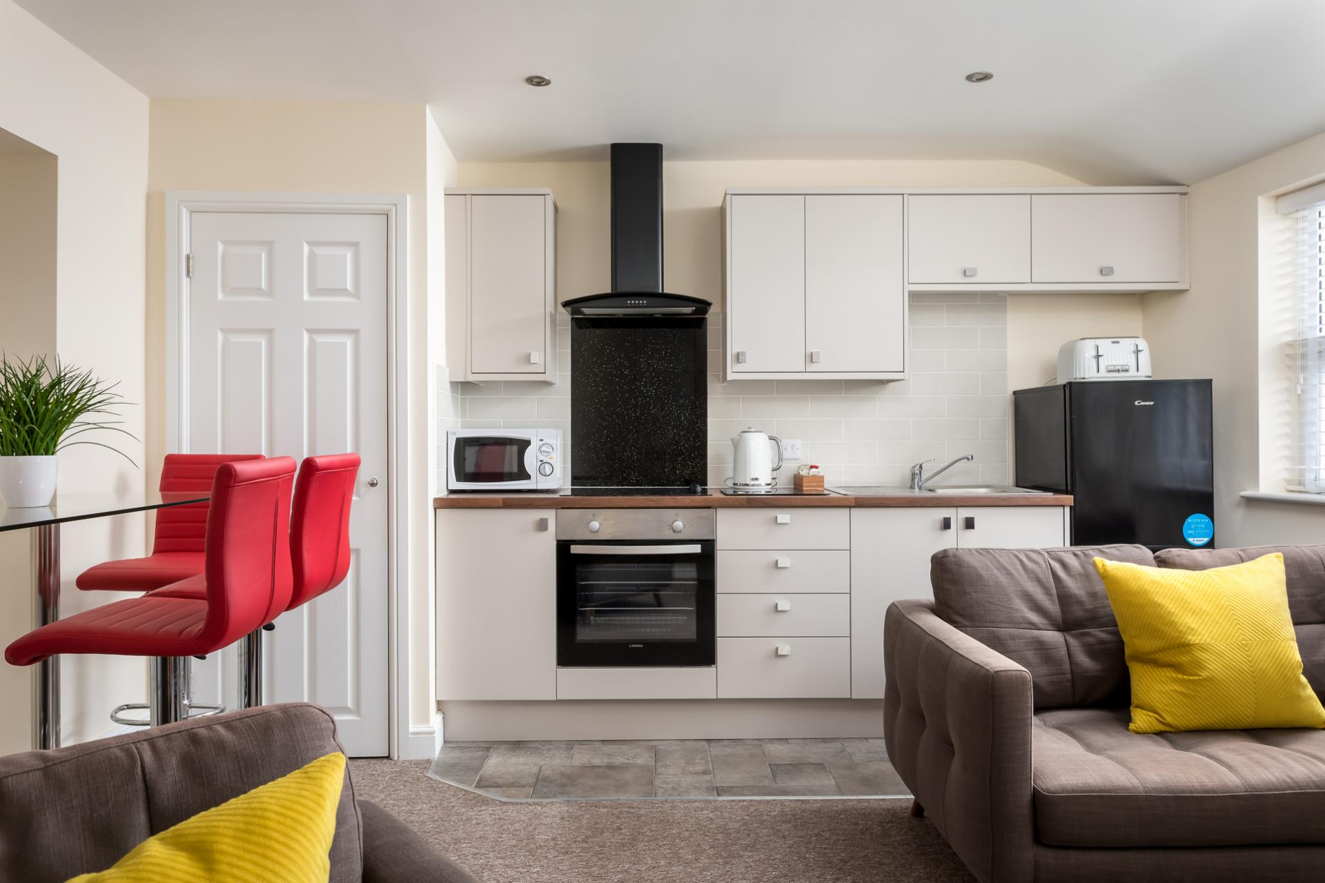 Open-plan living area at High Street Serviced Apartment