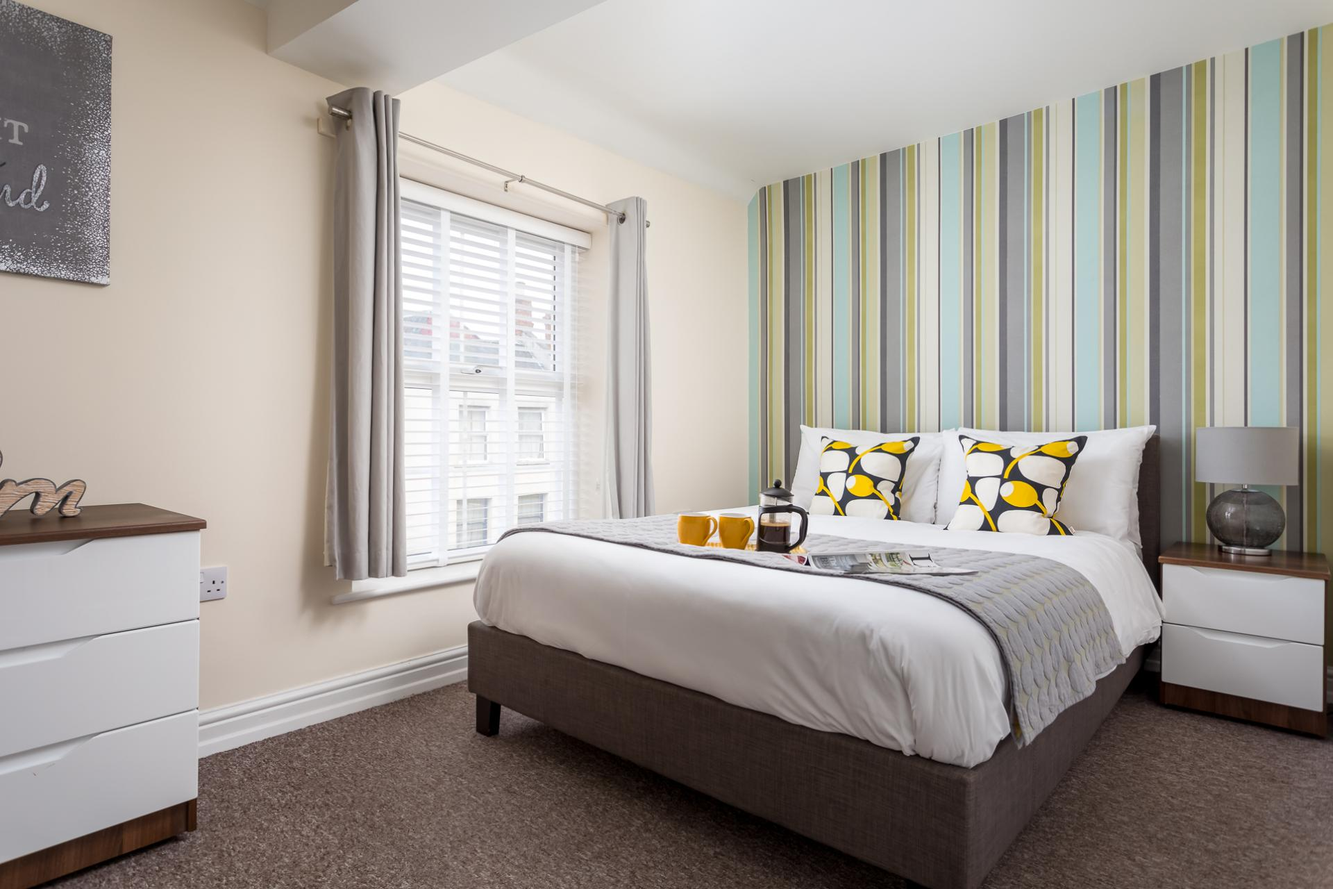 Double bed at High Street Serviced Apartment