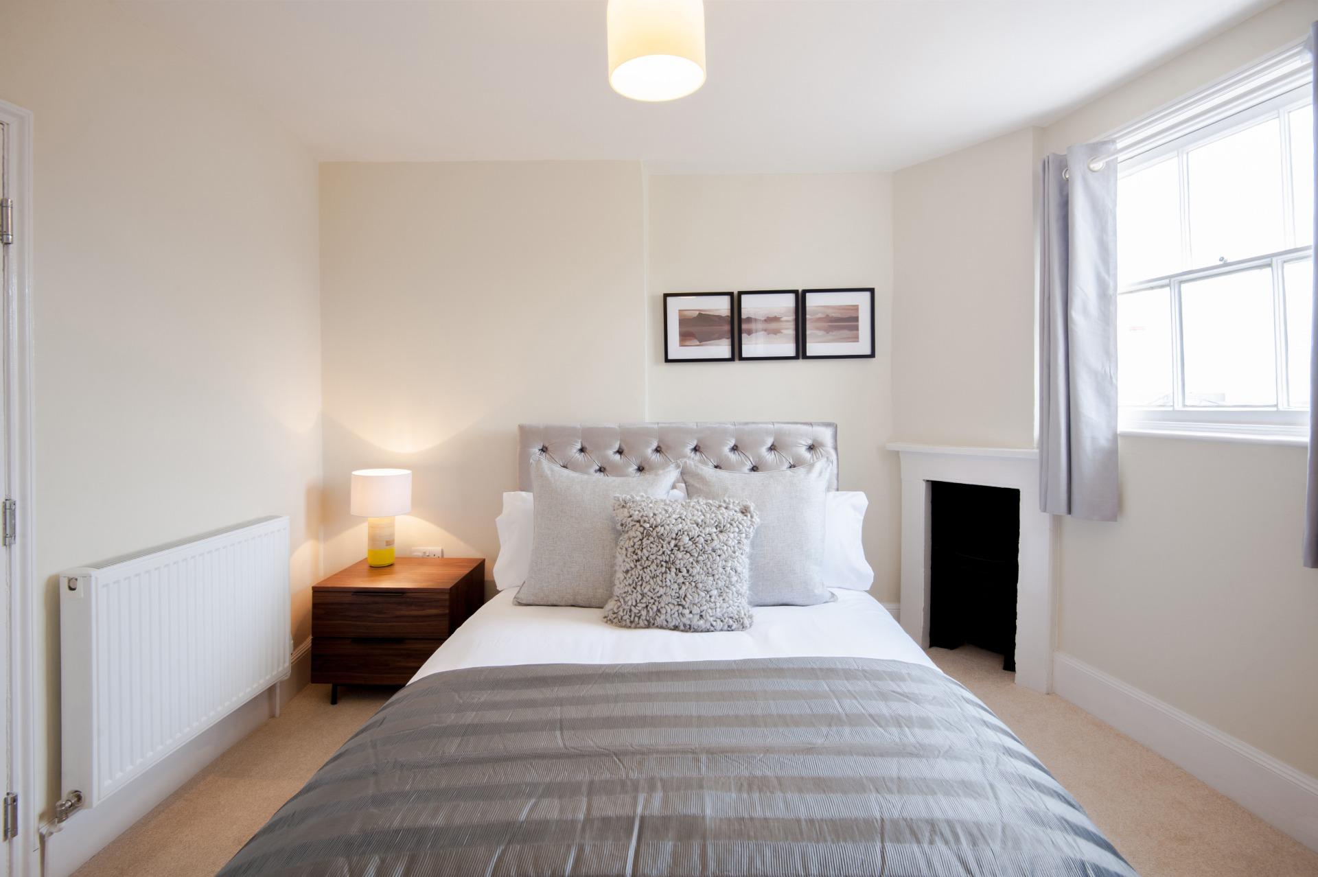 Bed at High Street Duplex Apartment