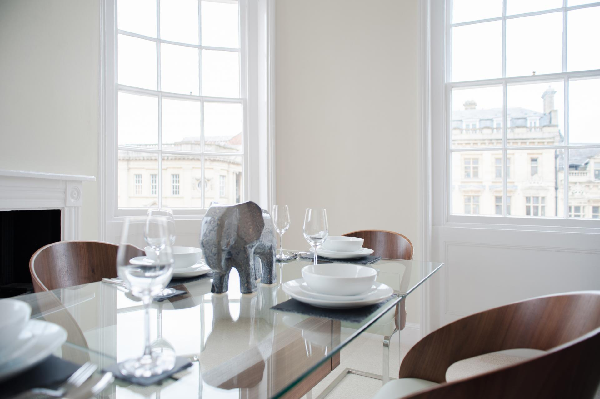 Bright dining table at High Street Duplex Apartment