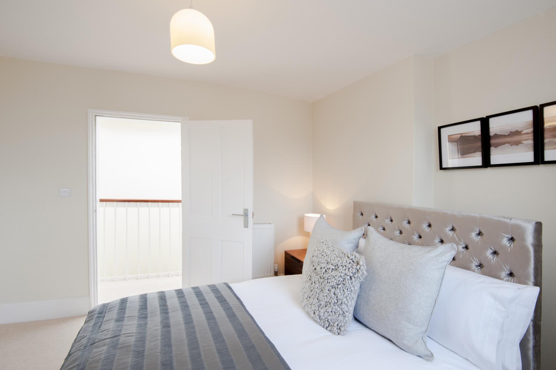Stylish bed at High Street Duplex Apartment