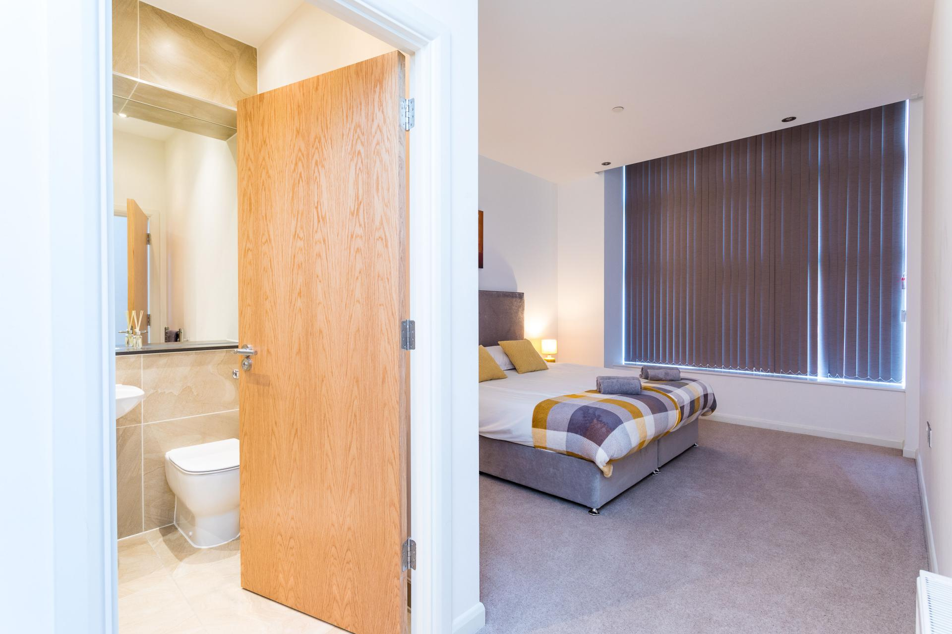 Spacious bedroom at Emerald House Apartments