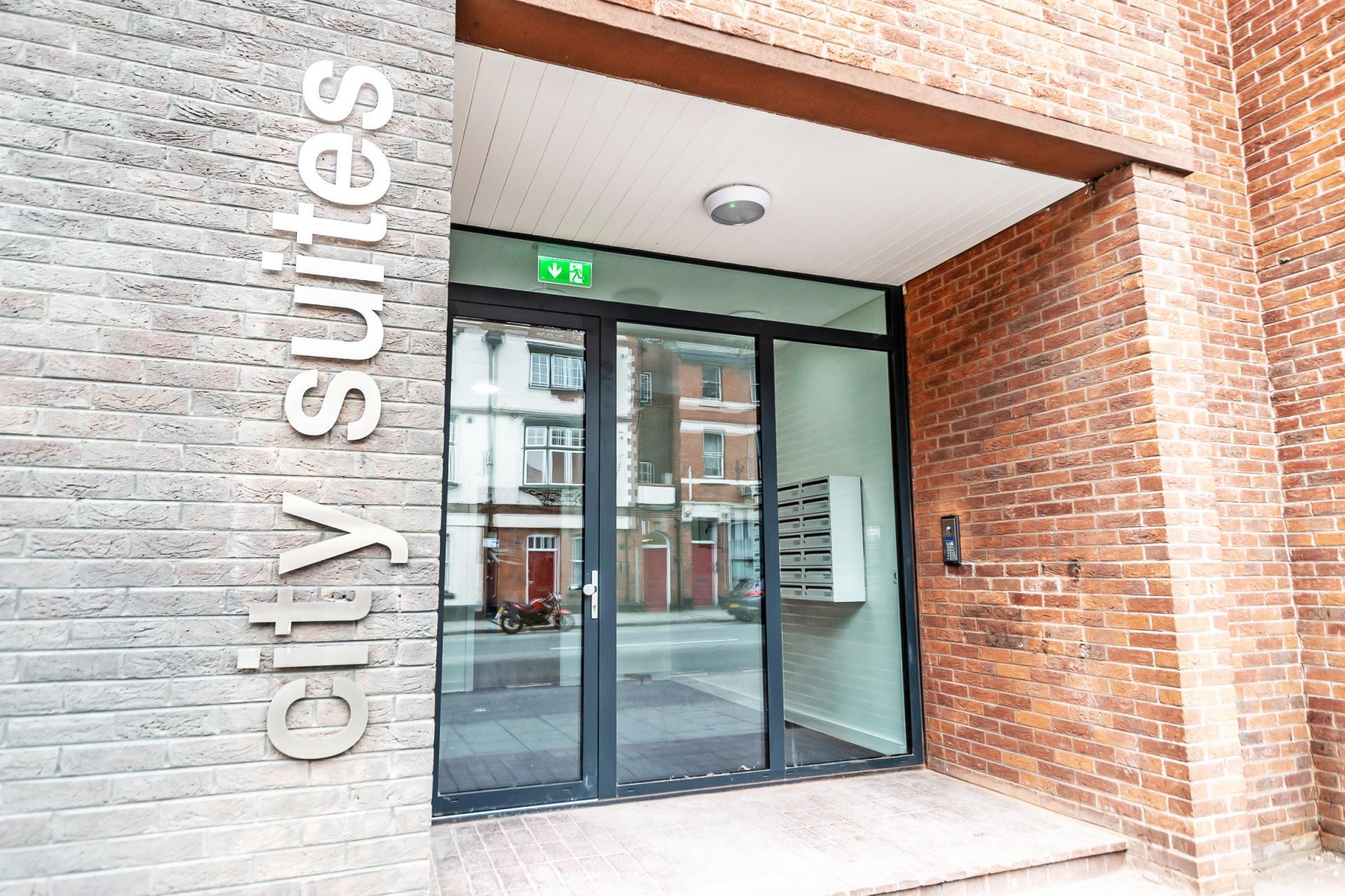 Entrance at City Suites Apartments