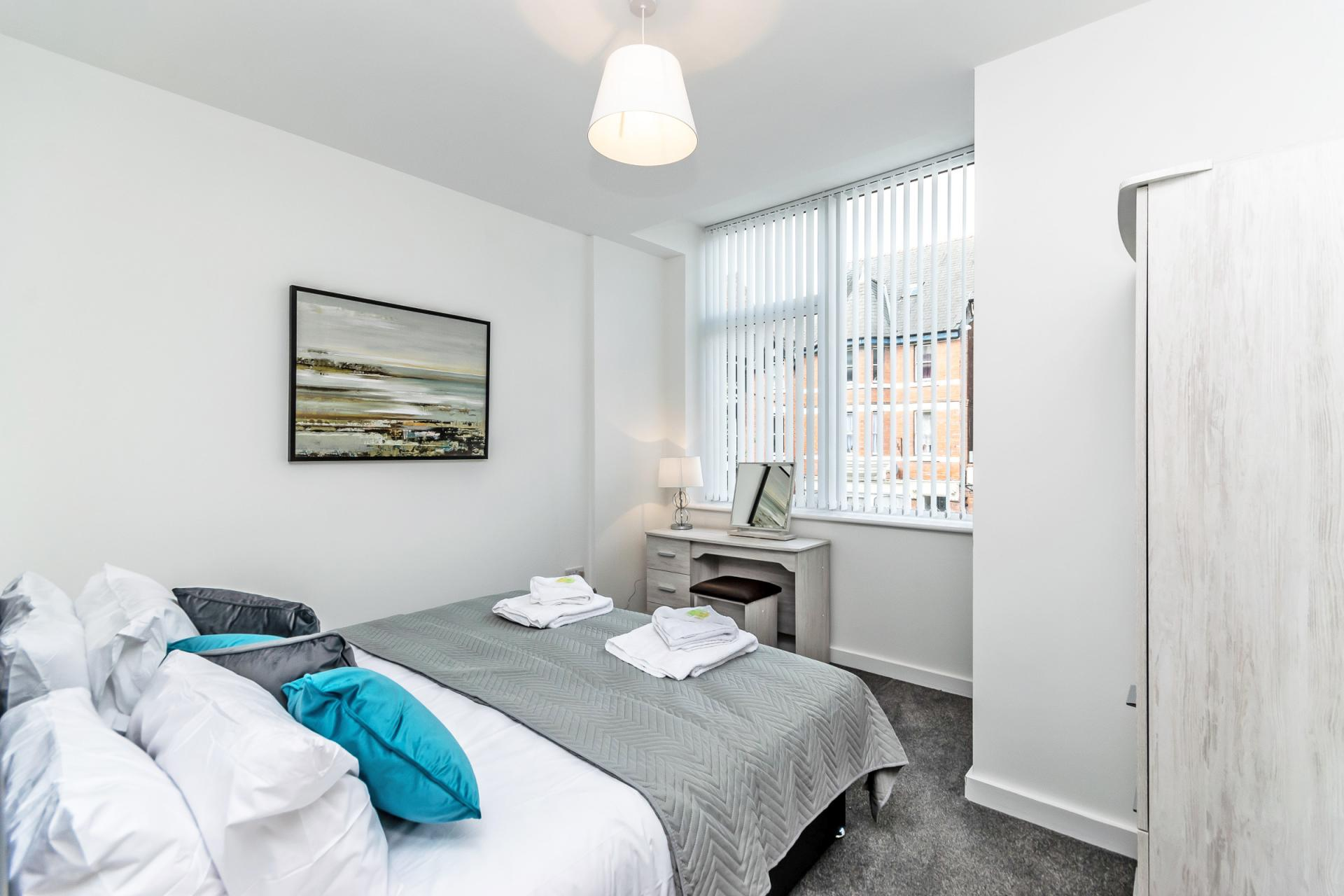 Comfortable bed at City Suites Apartments