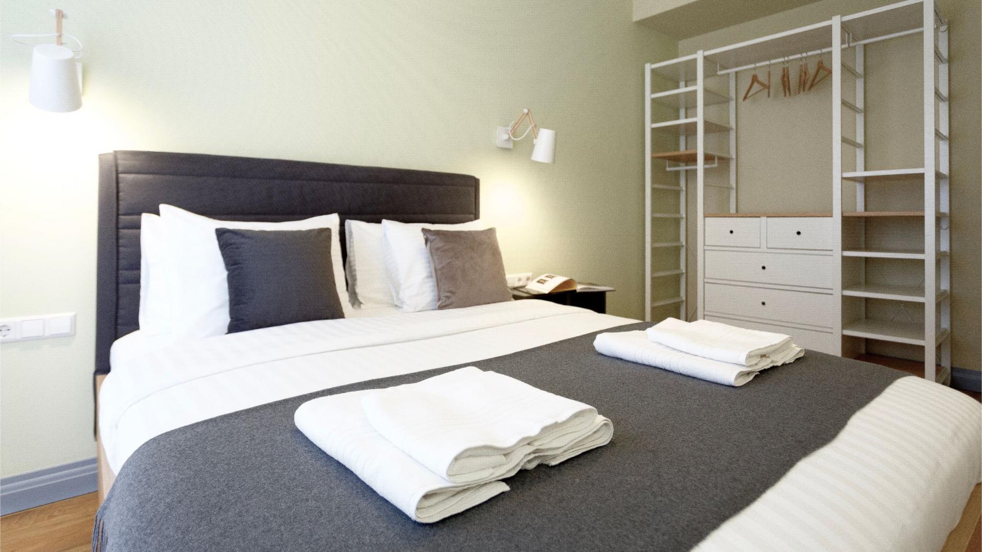 Comfortable bed at Siauliu Town Hall Apartment