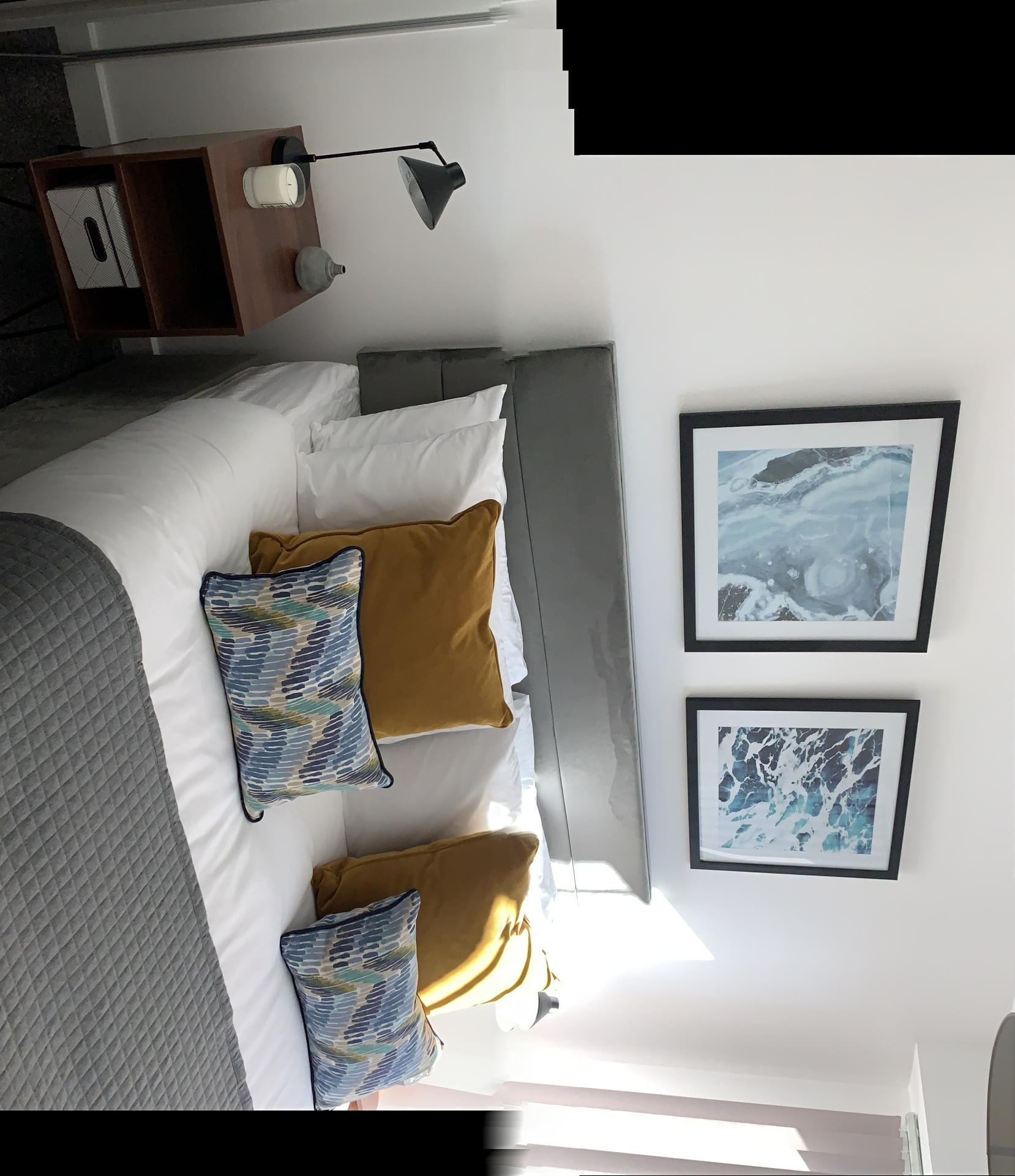 Modern bedroom at The Forum Apartments