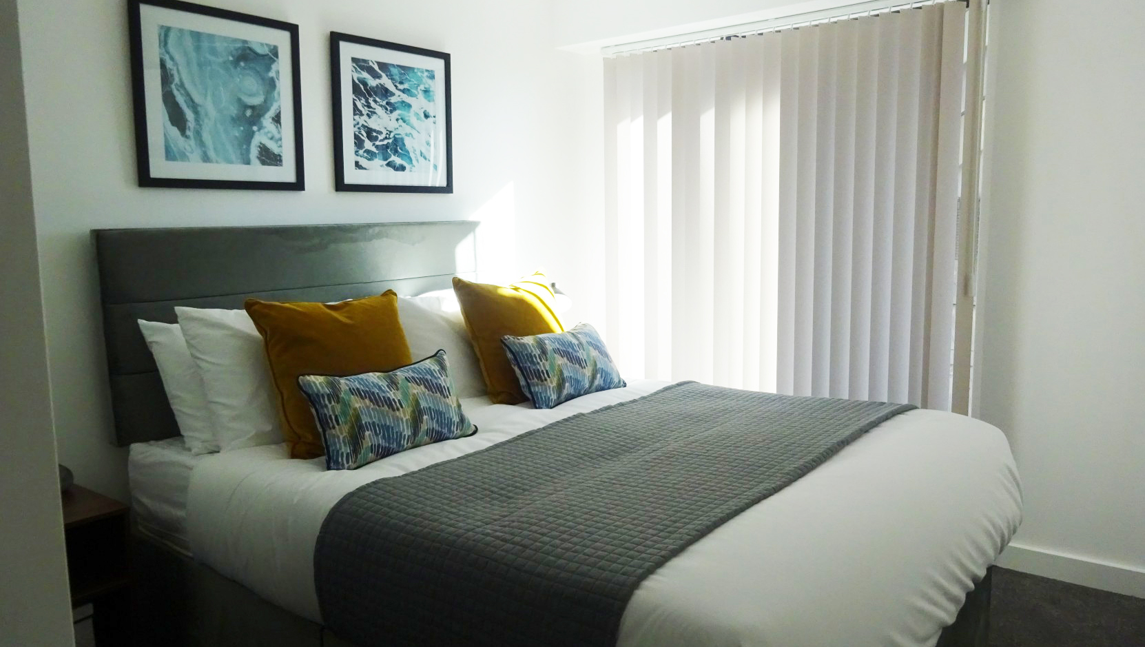 Stylish bedroom at The Forum Apartments