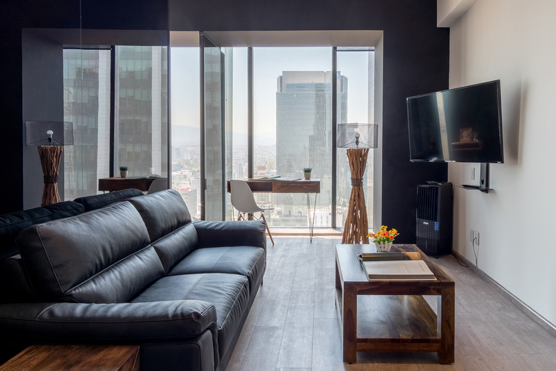Living room at Magenta Apartment Reforma