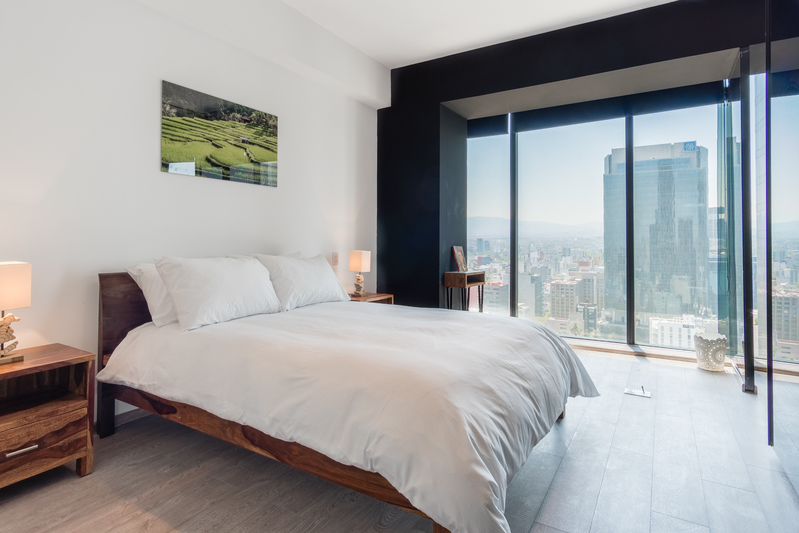 Bedroom at Magenta Apartment Reforma