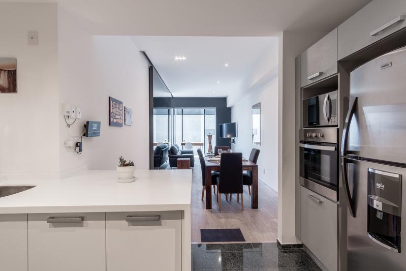 Kitchen facilities at Magenta Apartment Reforma